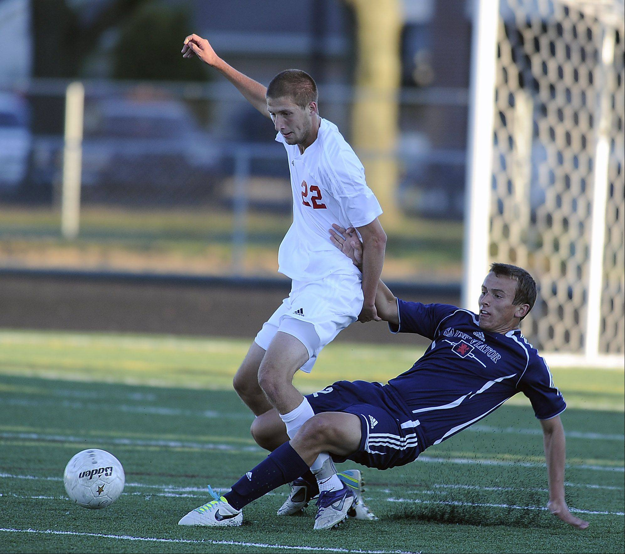 Palatine's Dan Cushing, left, and St. Viator's Jon Surdam battle for the ball in the first period Thursday at Palatine.