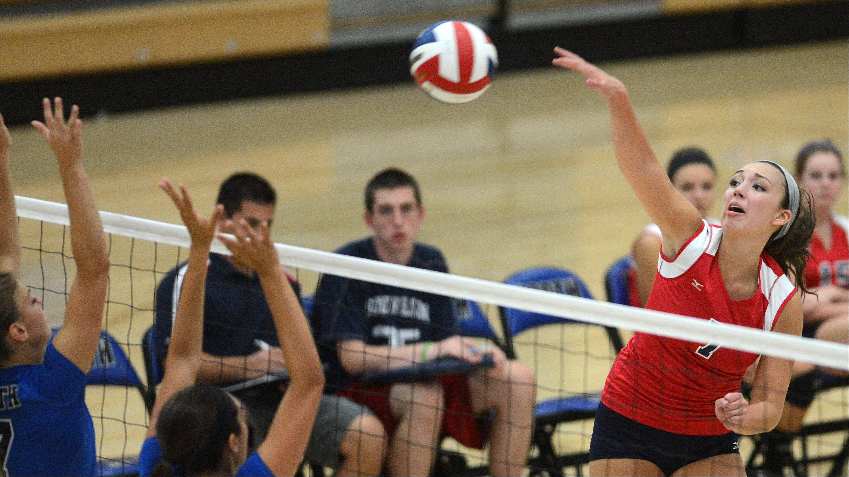 South Elgin's Ashley Oandasan drives the ball past a pair of St. Charles North blockers during Thursday's game in St. Charles.