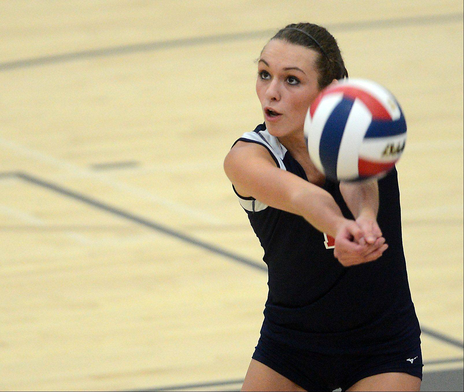 South Elgin's Katie Innis returns serve against St. Charles North during Thursday's game in St. Charles.