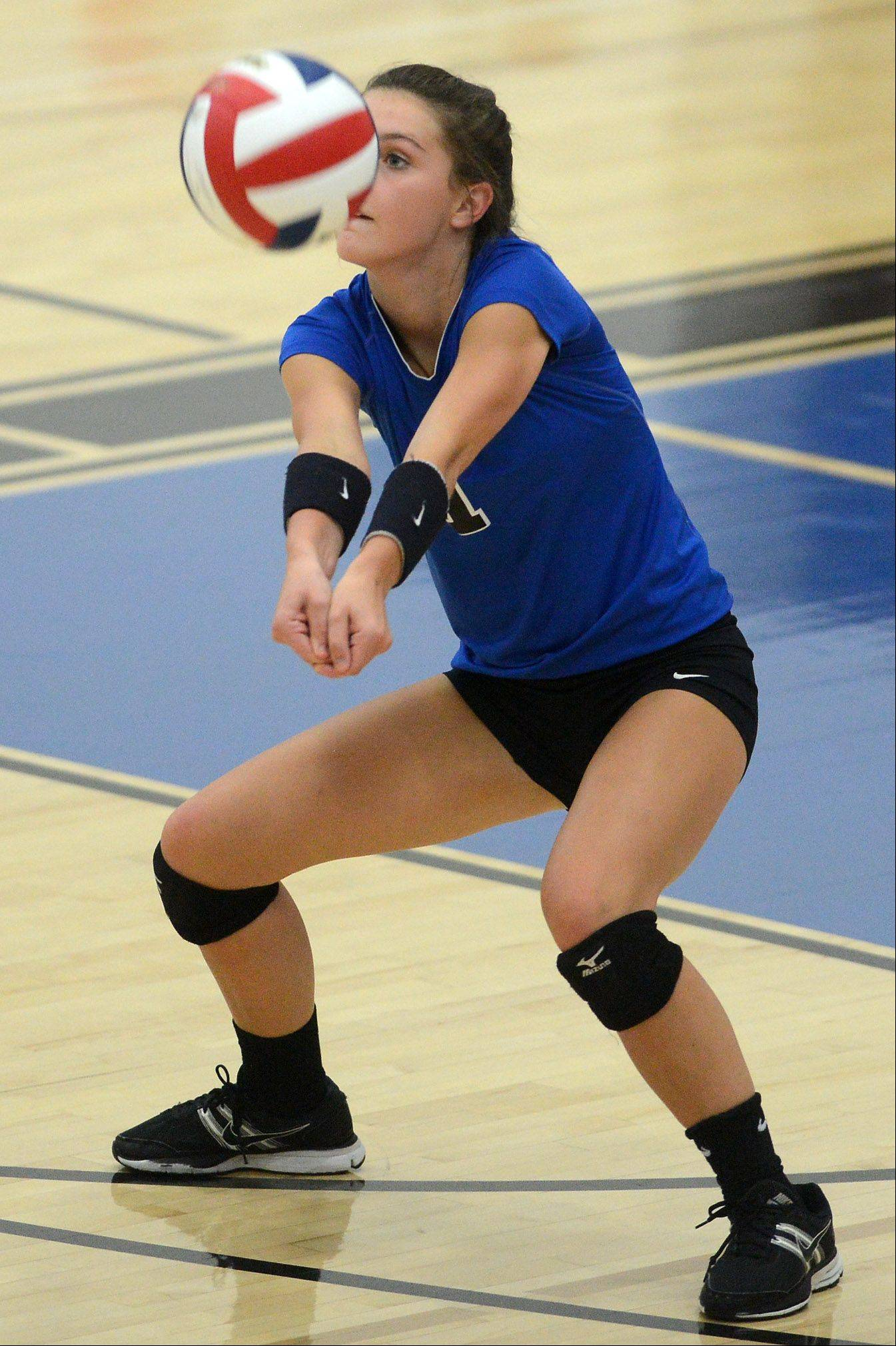 St. Charles North's Sam Lappin returns serve against South Elgin during Thursday's game in St. Charles.