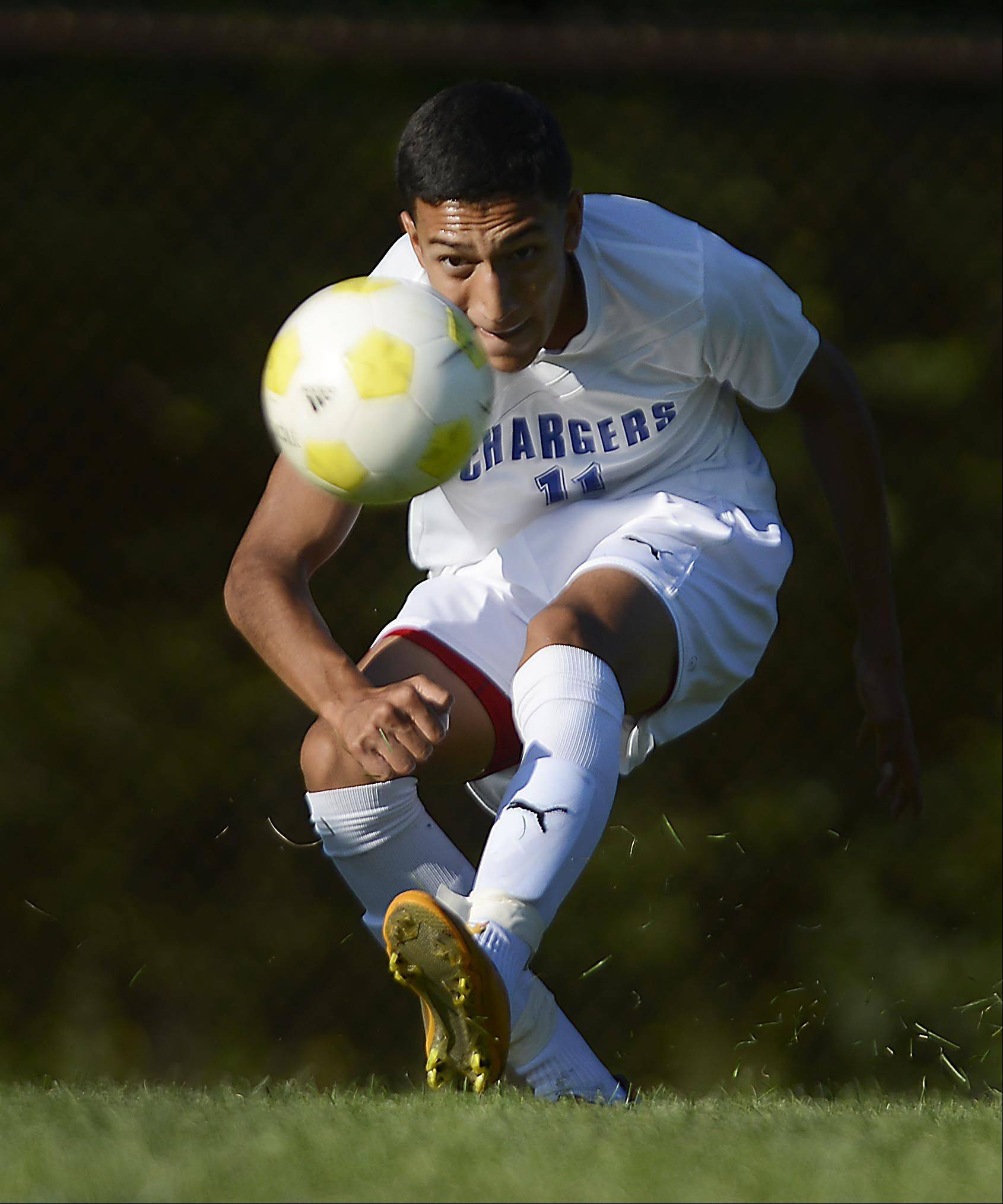 Dundee-Crown's Juan Ramos shoots against Hampshire Thursday in Carpentersville. The shot was stopped.