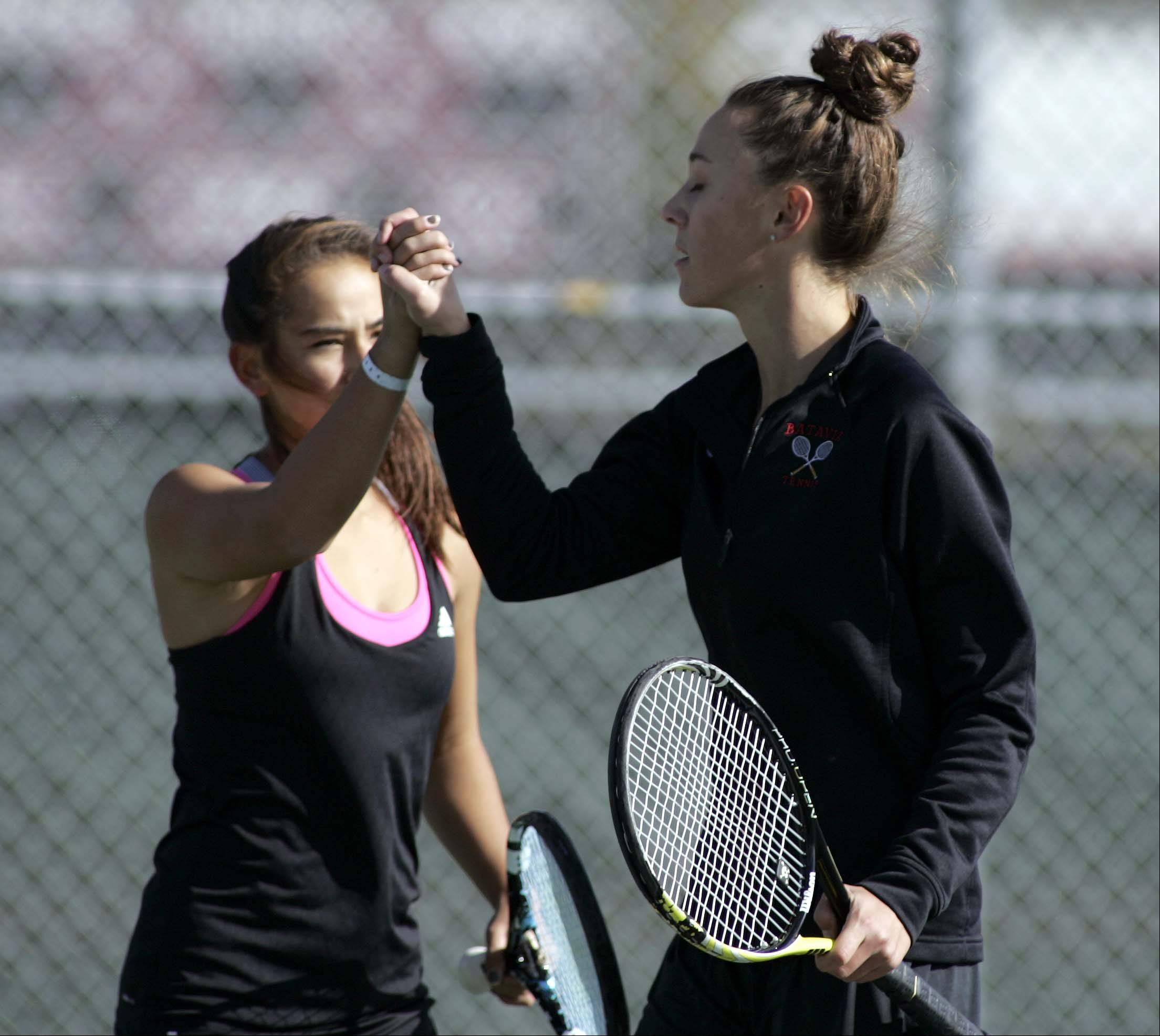 Brian Hill/bhill@dailyherald.com ¬ Batavia's Jenny Mizikar, right, and Amelia Cogan, left, celebrate a point during doubles play at the Upstate Eight Rive tennis meet Saturday October 6, 2012 at Elgin High School.