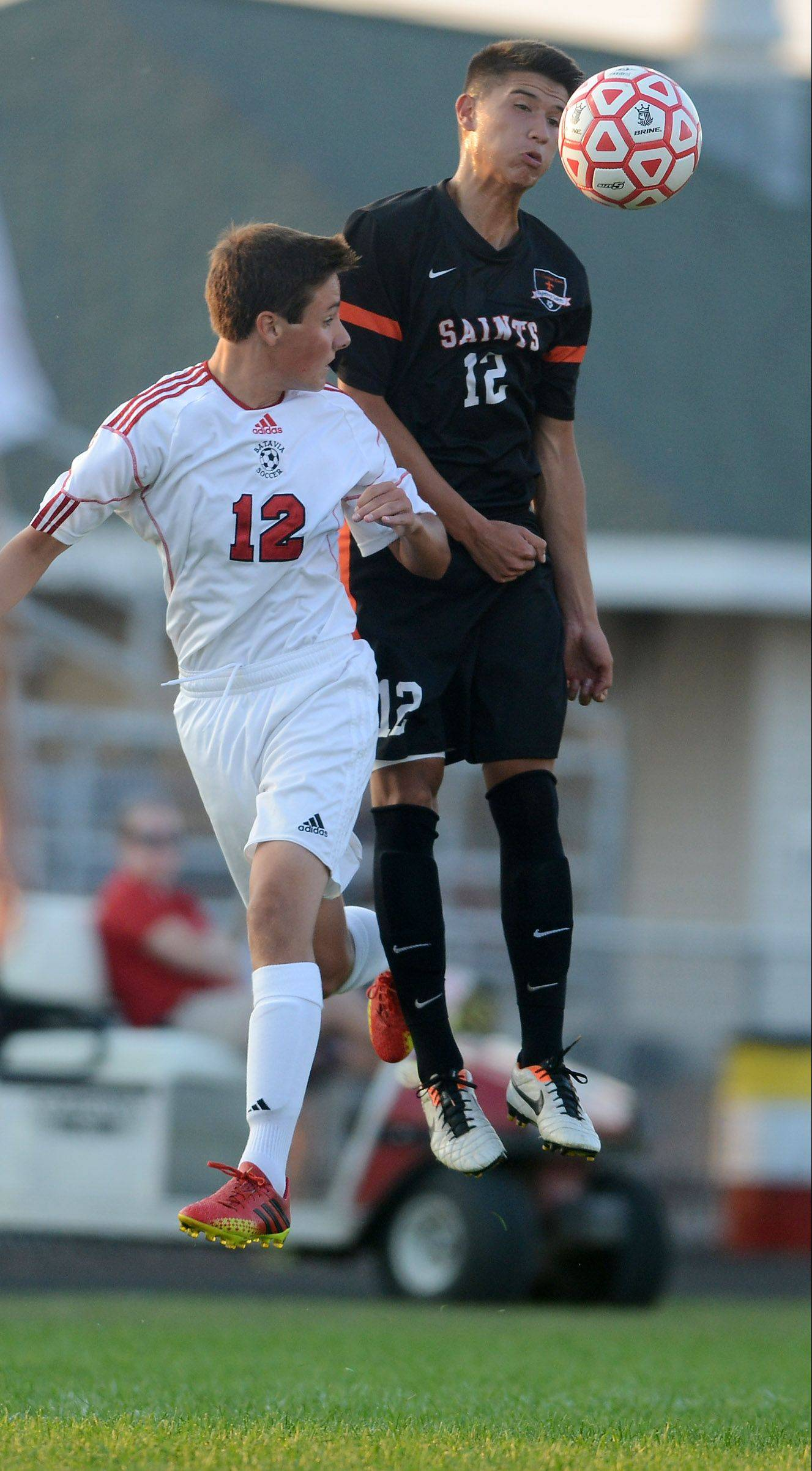 Batavia's Brandon Yunker and St. Charles East's Brandon Villanueva go up for a header during last week's game in Batavia.