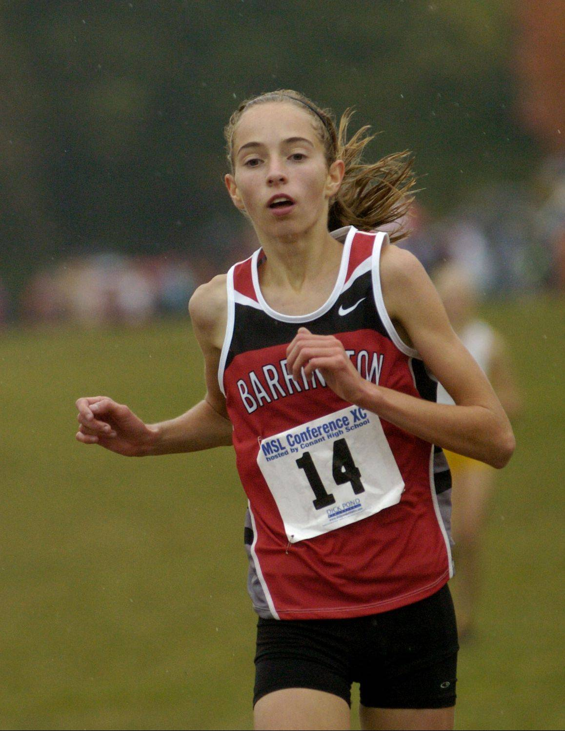 Lauren Conroy of Barrington heads for victory in least year's Mid-Suburban League meet. She not only has a talent for running but is an accomplished musician.