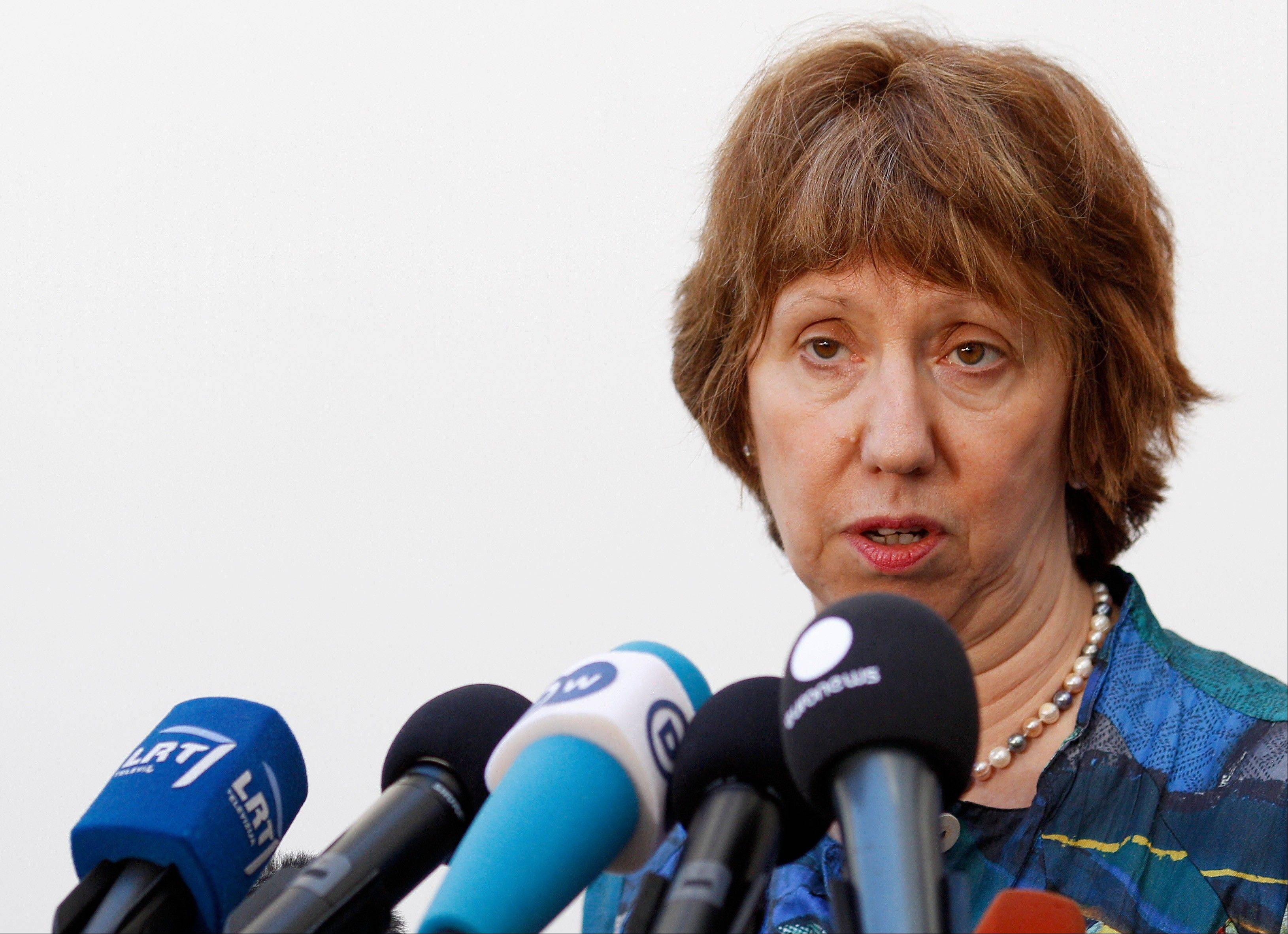 European foreign policy chief Catherine Ashton talks with journalists as she arrives for an informal meeting of EU Ministers for Foreign Affairs in Lithuania, Friday, Sept. 6, 2013. In a setback for Western efforts to tighten sanctions against Iran, a top European Union court on Friday threw out penalties imposed on several Iranian businesses for their alleged ties to the country�s disputed nuclear program.
