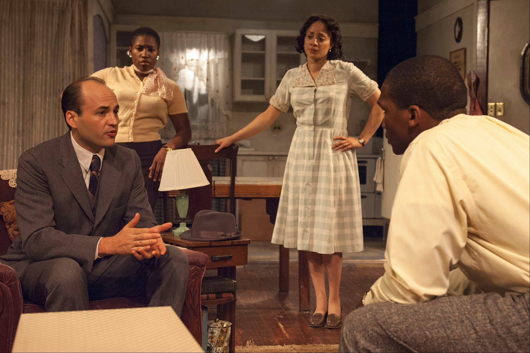 "Beneatha (Mildred Marie Langford), second from left, Ruth (Toni Martin) and Walter (Jerod Haynes), right, recognize a bribe when Clybourne Park Improvement Association representative Karl Lindner (Chris Rickett) proposes it in TimeLine Theatre's ""A Raisin in the Sun."""