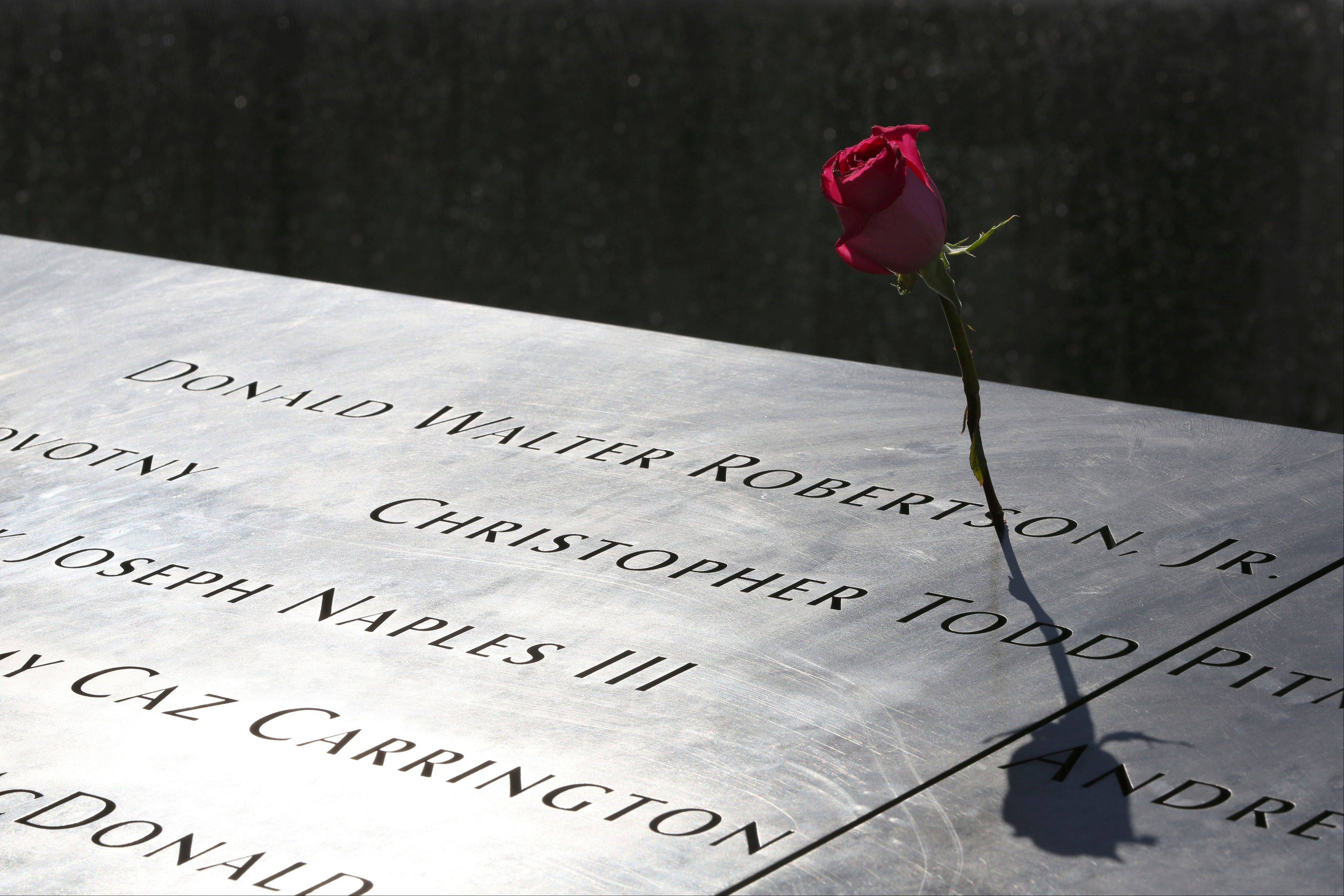 A rose is placed next to the name of a victim of the terrorist attacks Friday, at the North Pool of the National September 11 Memorial and Museum.