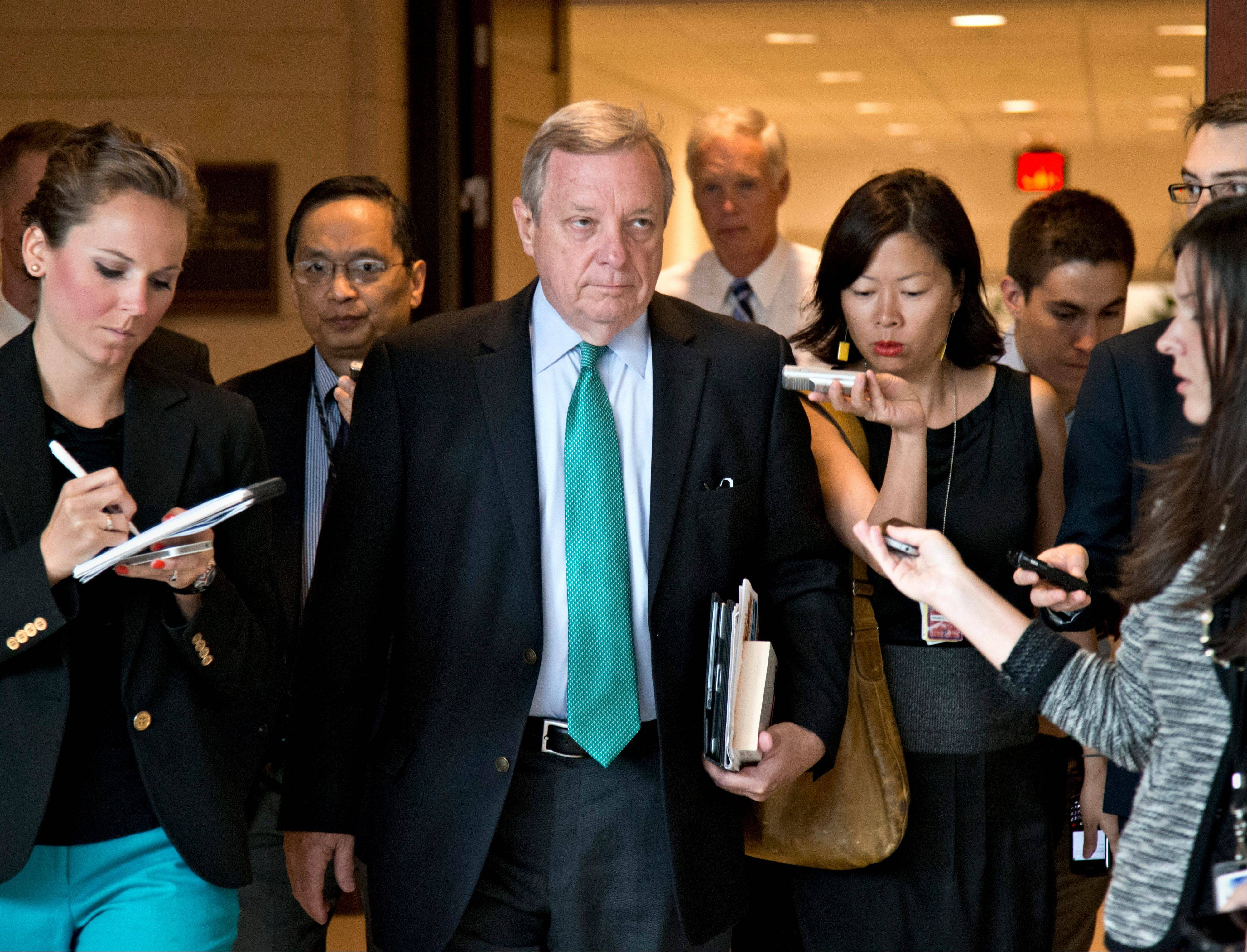 Sen. Dick Durbin of Illinois, the Senate assistant Democratic majority leader, arrives Wednesday for a top-secret briefing for senators with Secretary of State John Kerry at the Capitol in Washington.