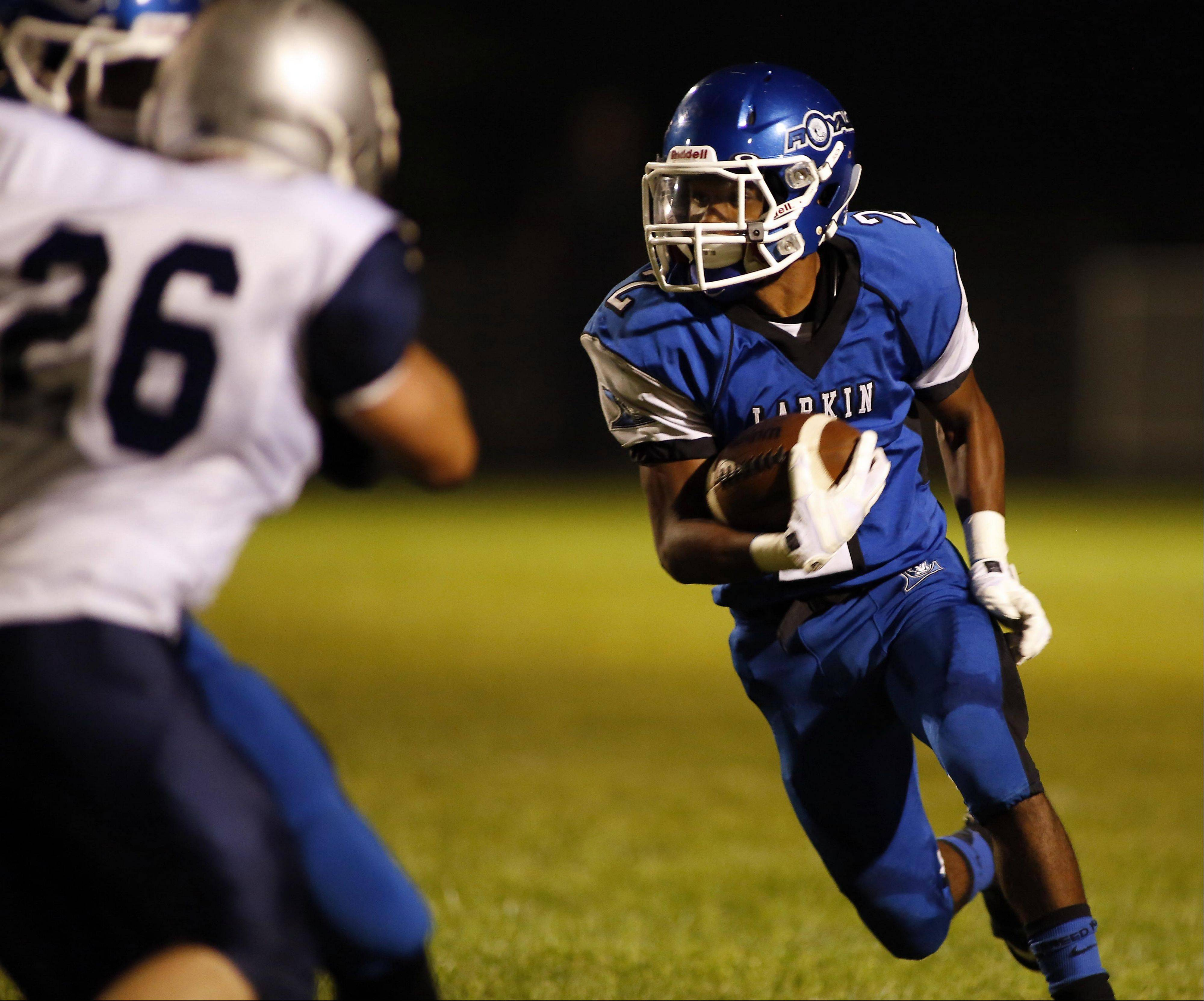 Larkin�s Damion Clemons looks to gain yardage Friday night against West Chicago at Memorial Field. Clemons� 2-yard run in overtime lifted the Royals to a 20-12 win.