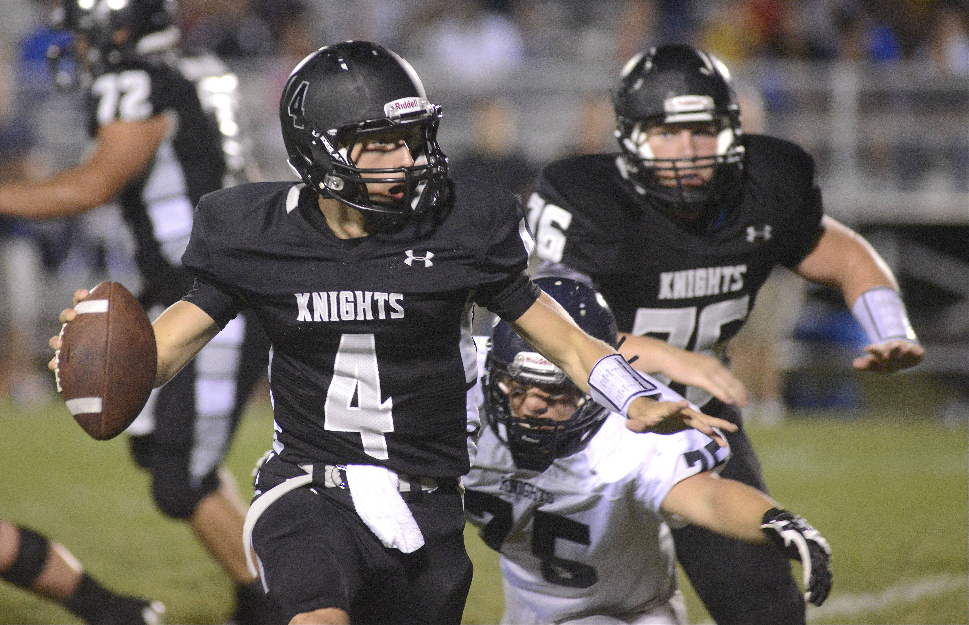Kaneland quarterback Drew David looks to pass the ball before being sacked by IC Catholic Prep�s Sam Lytton in the second quarter.