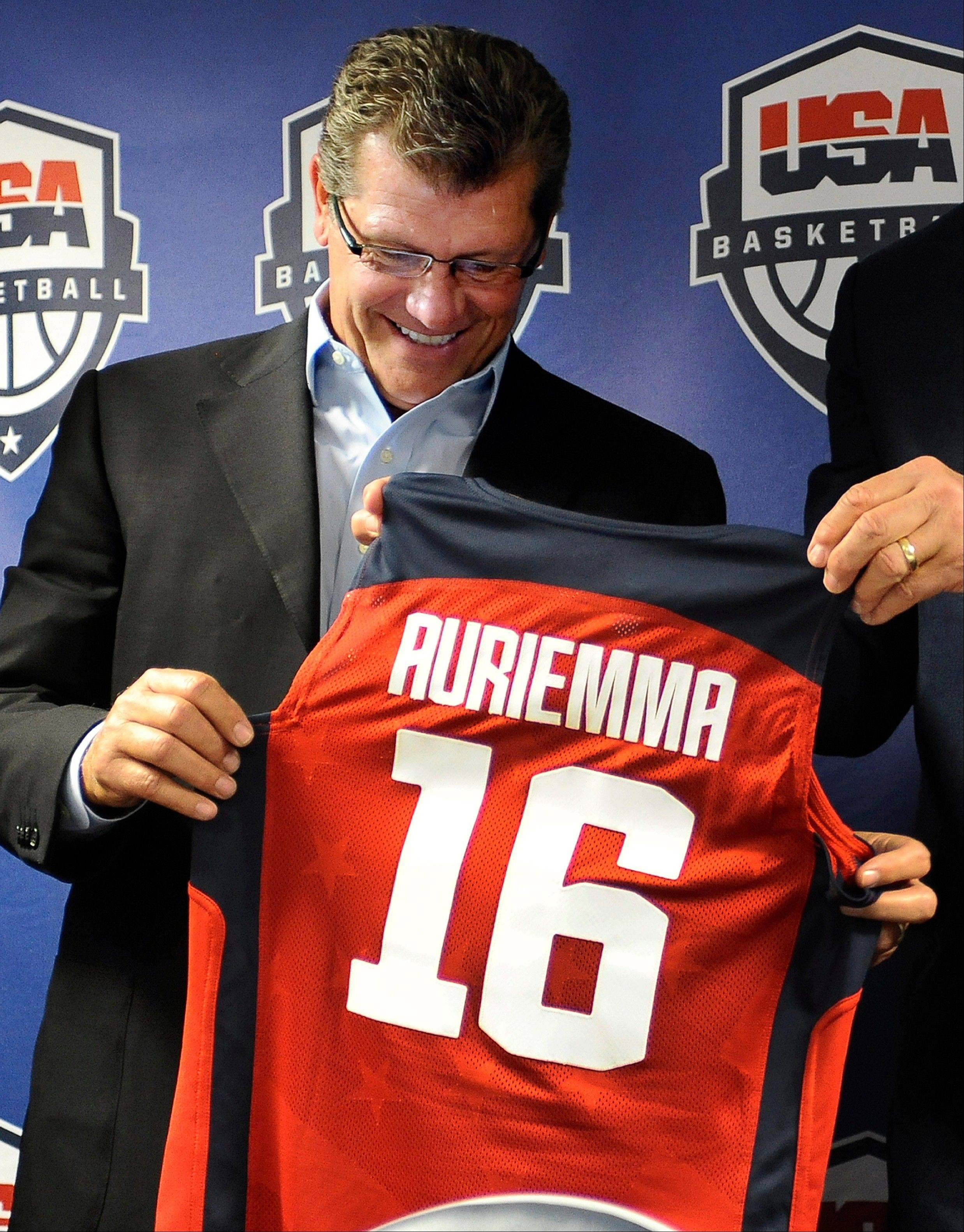 Connecticut head coach Geno Auriemma smiles after receiving a team jersey Friday at a news conference announcing he will head the U.S. women�s basketball team at the 2016 Rio de Janeiro Olympics.