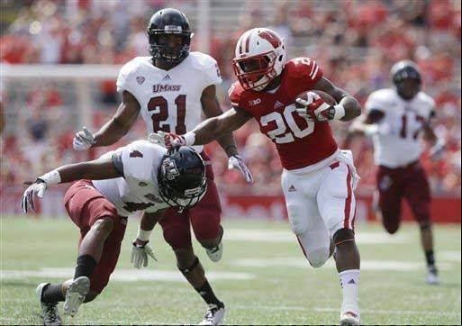 Wisconsin�s James White gains yards in the first half of the Badgers� season-opening shutout of Massachusetts last week in Madison.