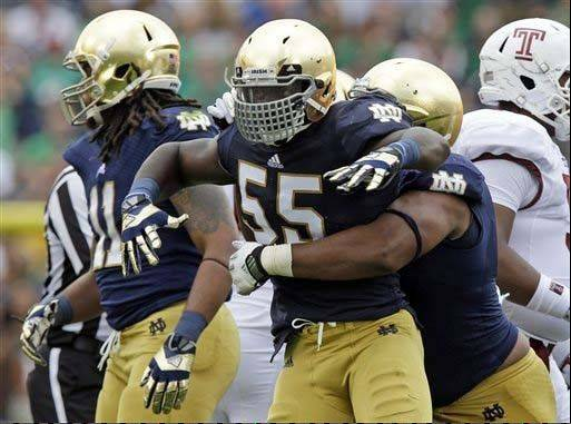 Notre Dame linebacker Prince Shembo celebrates as he�s hugged by teammate Stephon Tuitt after a tackle for a loss against Temple last Saturday in South Bend, Ind.
