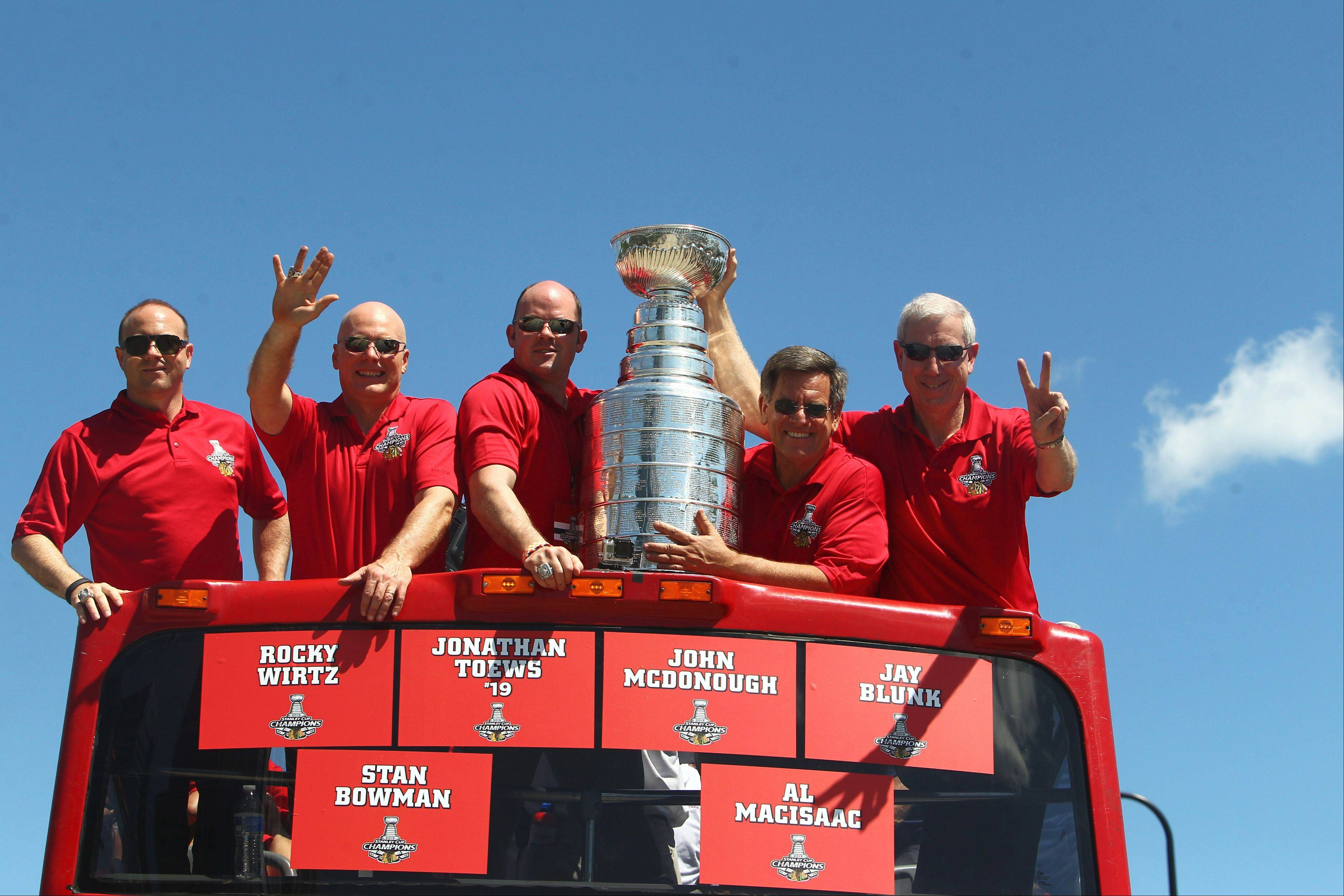 With the recent signings of Corey Crawford and Niklas Hjalmarsson to contract extensions, there may be more Stanley Cup parades ahead for the Blackhawks brass. From left: vice president/general manager Stan Bowman, executive vice president Jay Blunk, vice president Al MacIsaac, chairman Rocky Wirtz and CEO and president John McDonough.