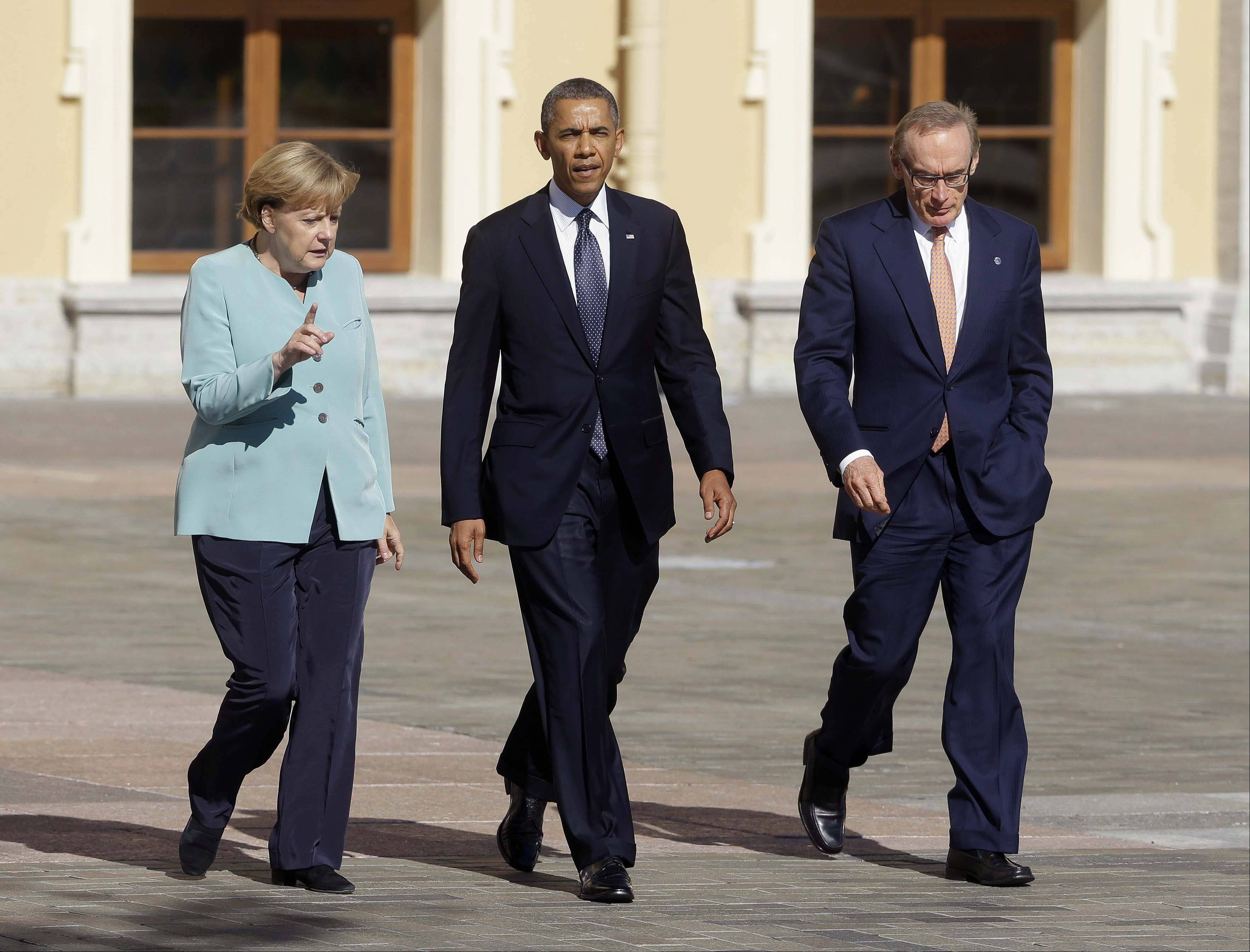 U.S. President Barack Obama walks with Germany's Chancellor Angela Merkel, left, and Australian Foreign Minister Bob Carr prior to the group photo at the G-20 summit at the Konstantin Palace in St. Petersburg, Russia.
