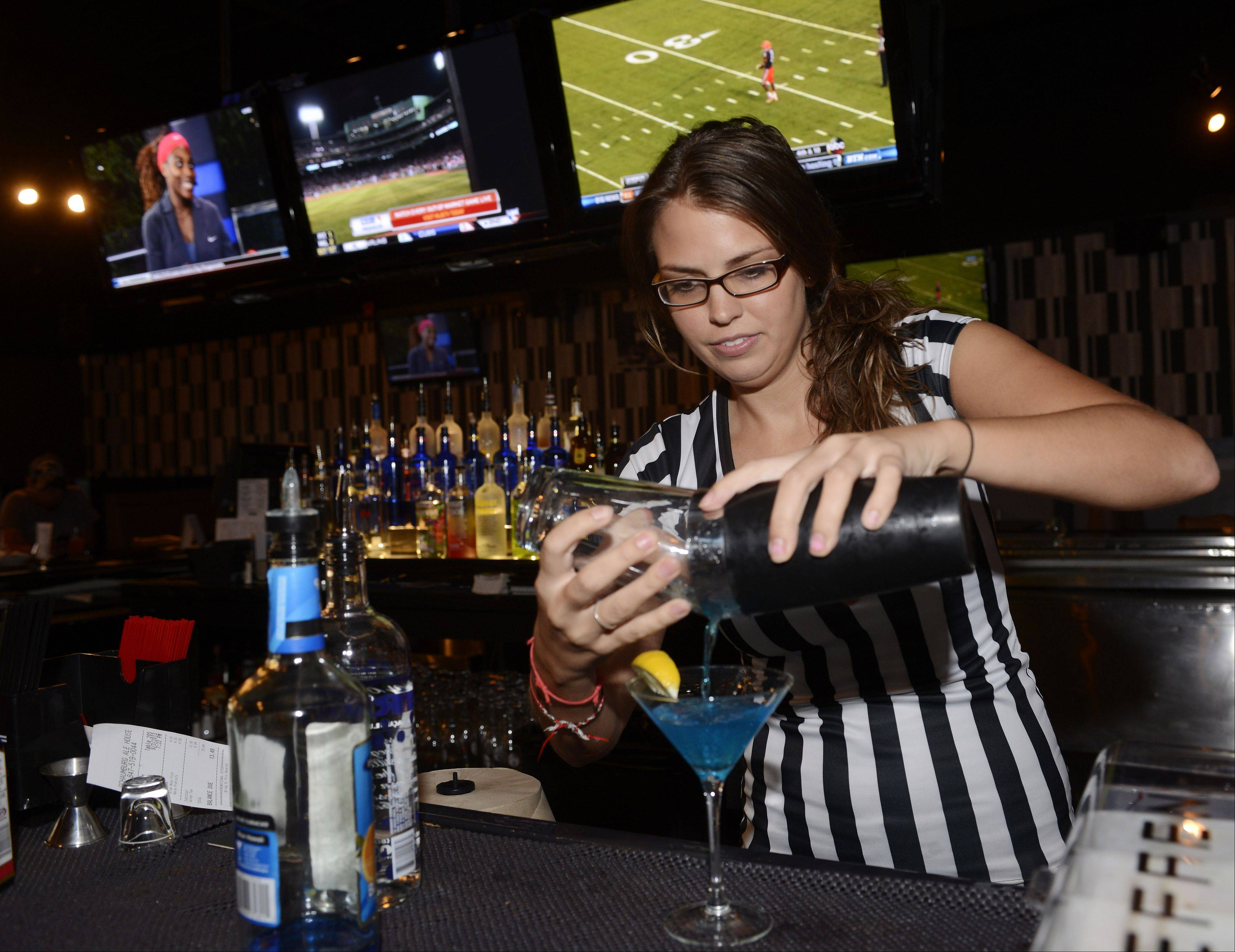 Bartender Lindsay Kamowski pours a martini at Schaumburg Ale House.