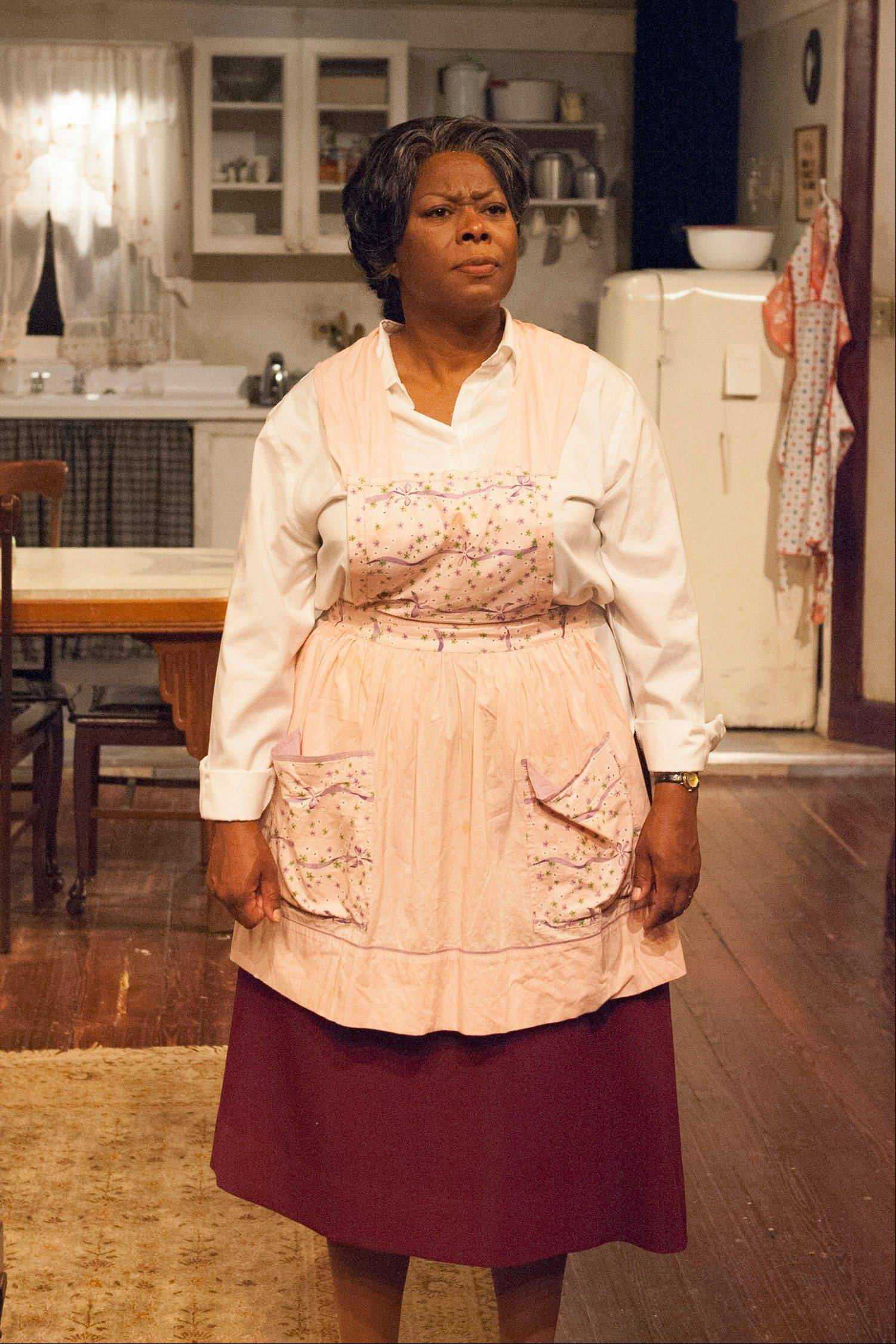 "Greta Oglesby is riveting as a mother determined to secure a better life for her family in TimeLine Theatre's revival of Lorraine Hansberry's ""A Raisin in the Sun."""