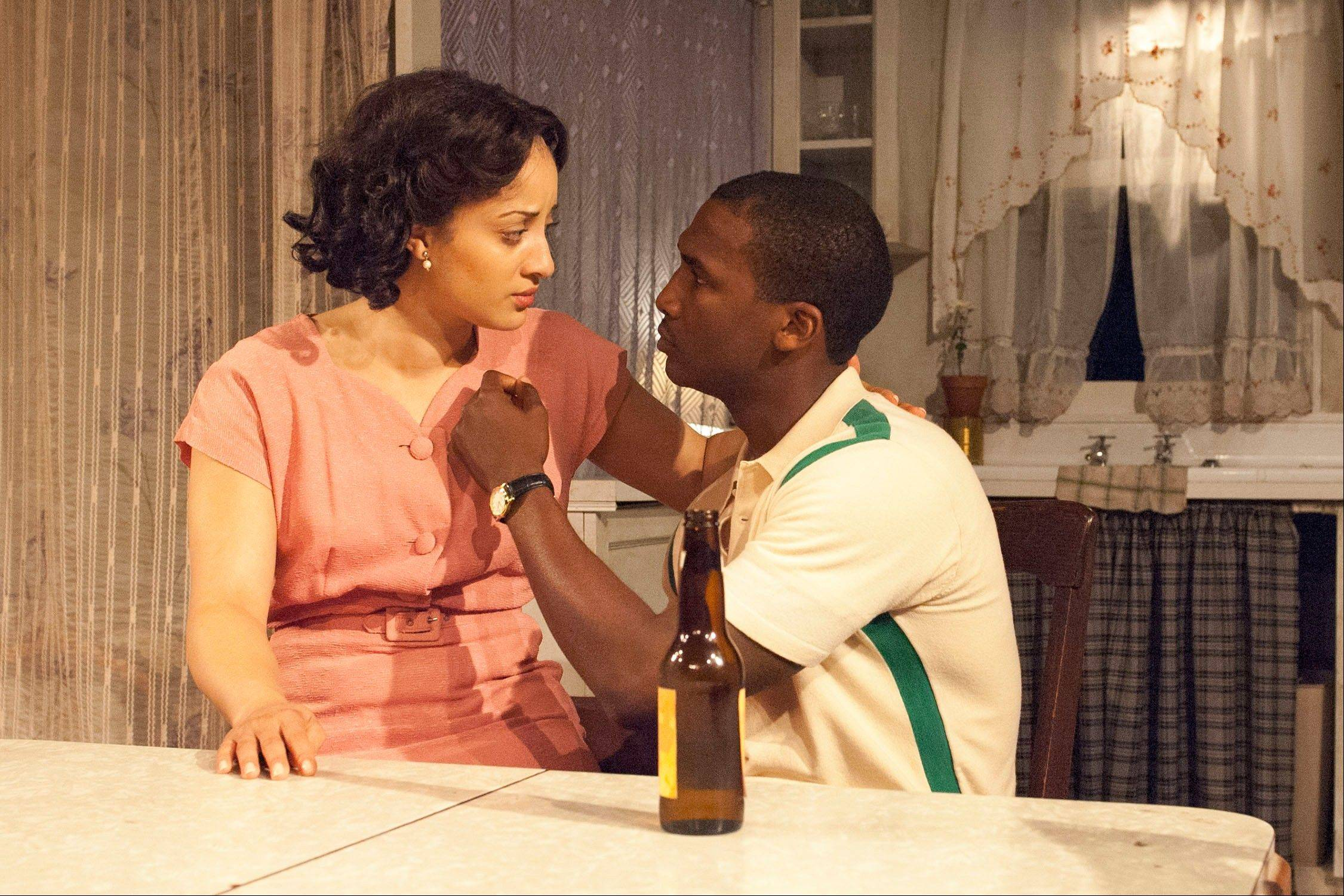 "Walter Lee Younger (Jerod Haynes) explains his dreams for the future to his wary wife, Ruth (Toni Martin), in TimeLine Theatre's revival of ""A Raisin in the Sun."""