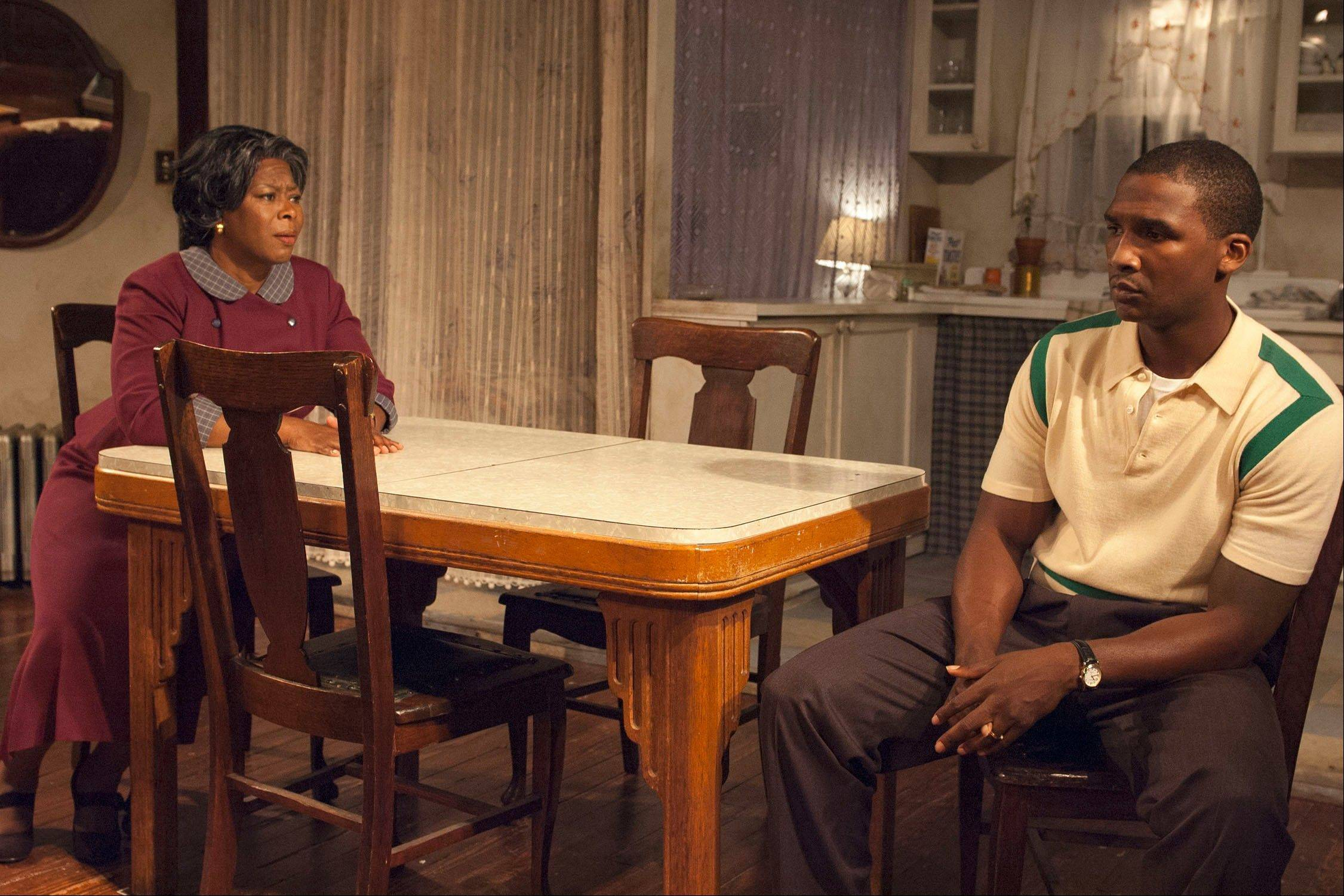 "Mama (Greta Oglesby) does her best to comfort and provide for her anguished son Walter (Jerod Haynes) in ""A Raisin in the Sun,"" running through Nov. 17, at TimeLine Theatre."