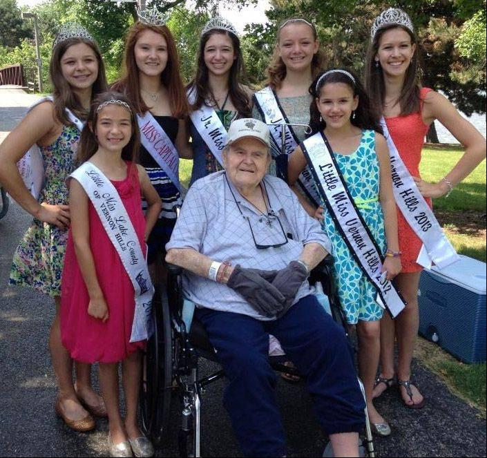 James Heier, who served as a Vernon Hills trustee from 1983 to 1995, died Sept. 1. Here he poses with pageant queens at a Heier Annual Fishing Derby.
