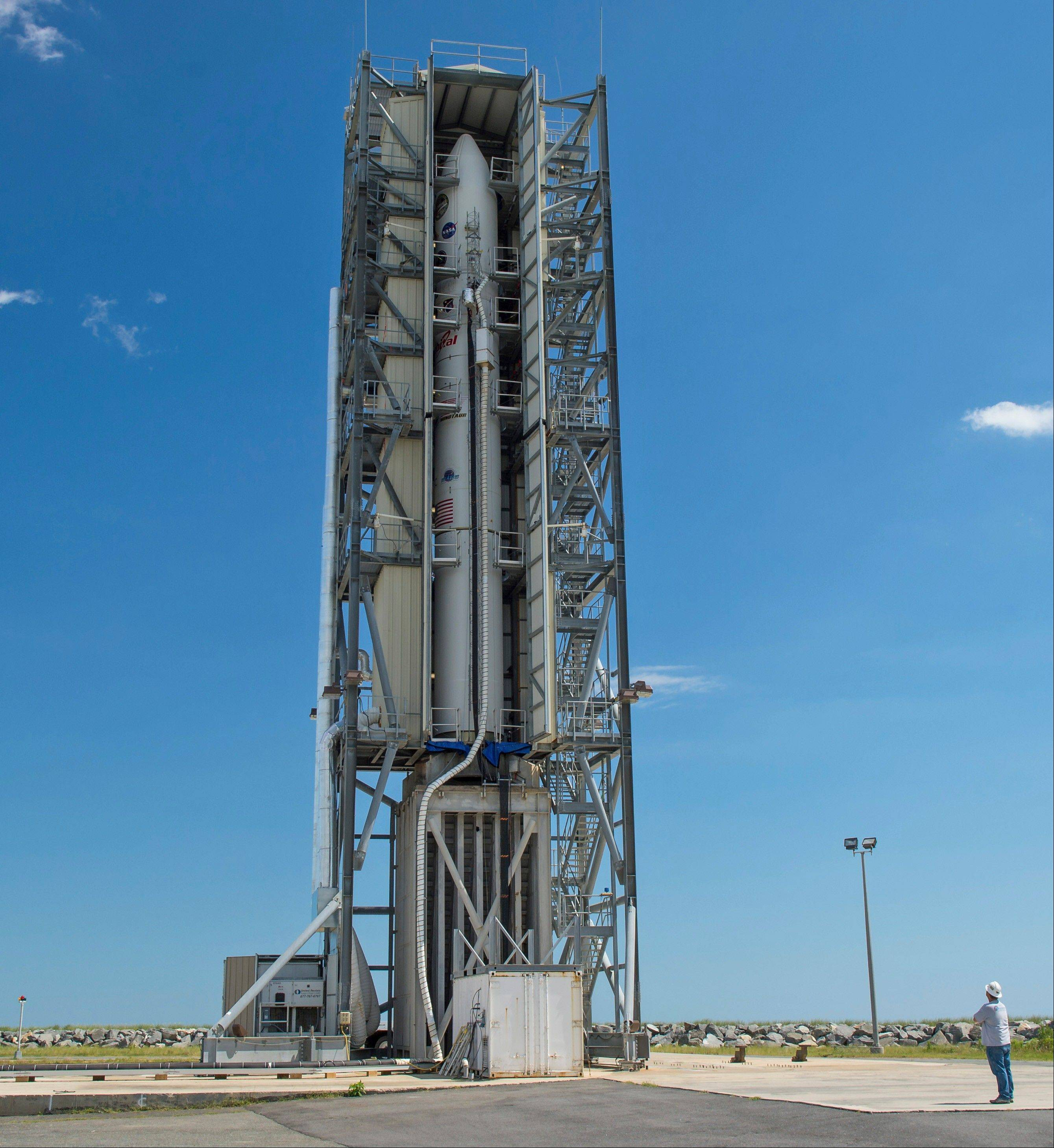 In this image provided by NASA, the doors of the gantry support structure are opened Friday to reveal the Minotaur V rocket on Pad 0B at the Mid-Atlantic Regional Spaceport at NASA's Wallops Flight Facility.