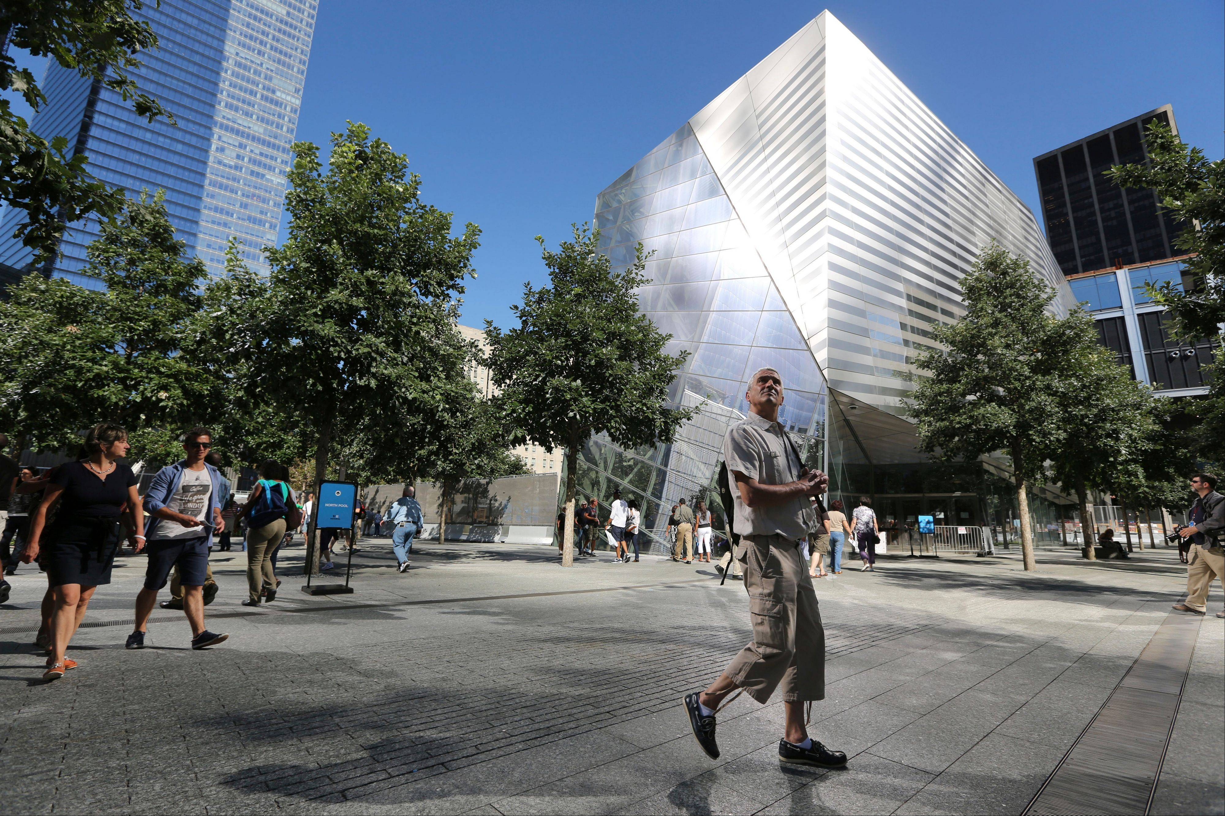 A visitor to the National September 11 Memorial and Museum takes in the sight Friday as he walks past the museum.