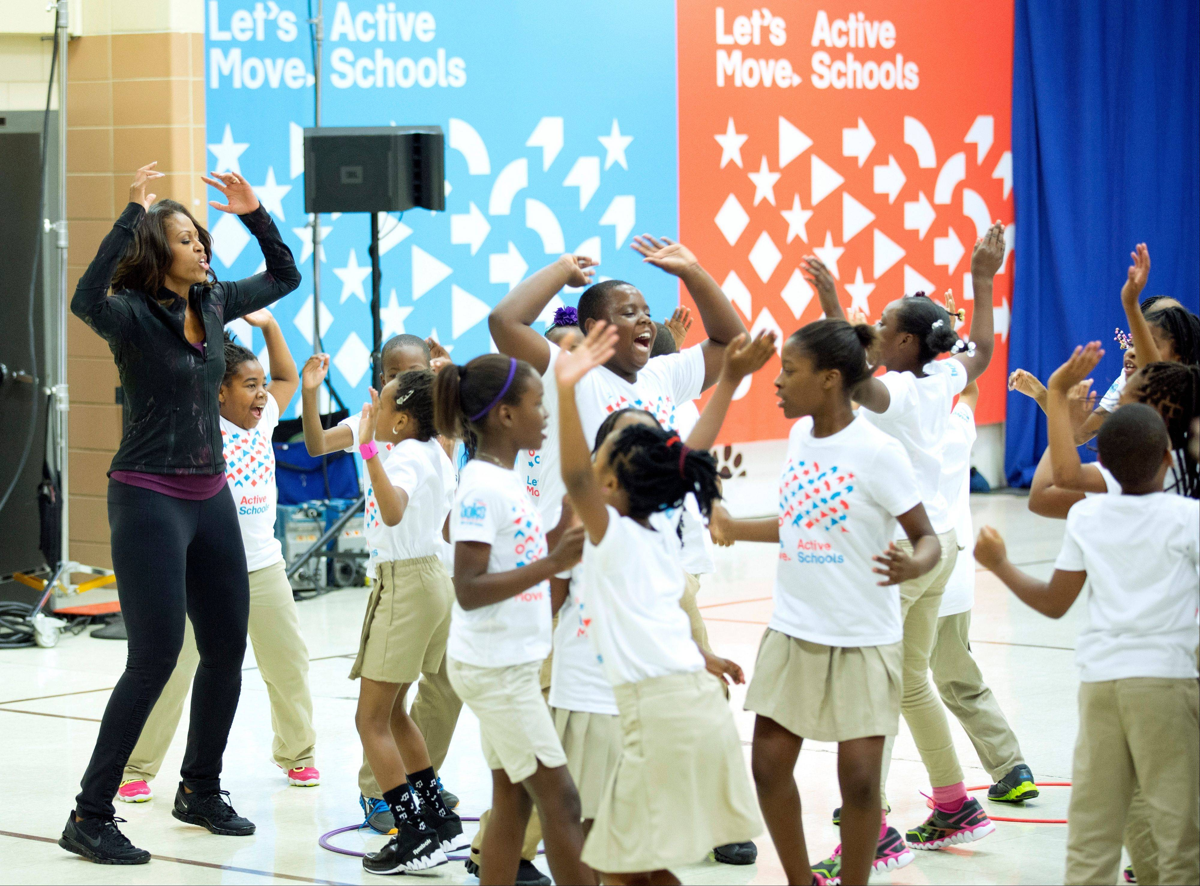 First lady Michelle Obama joins exercises with pupils Friday at Orr Elementary in Washington.