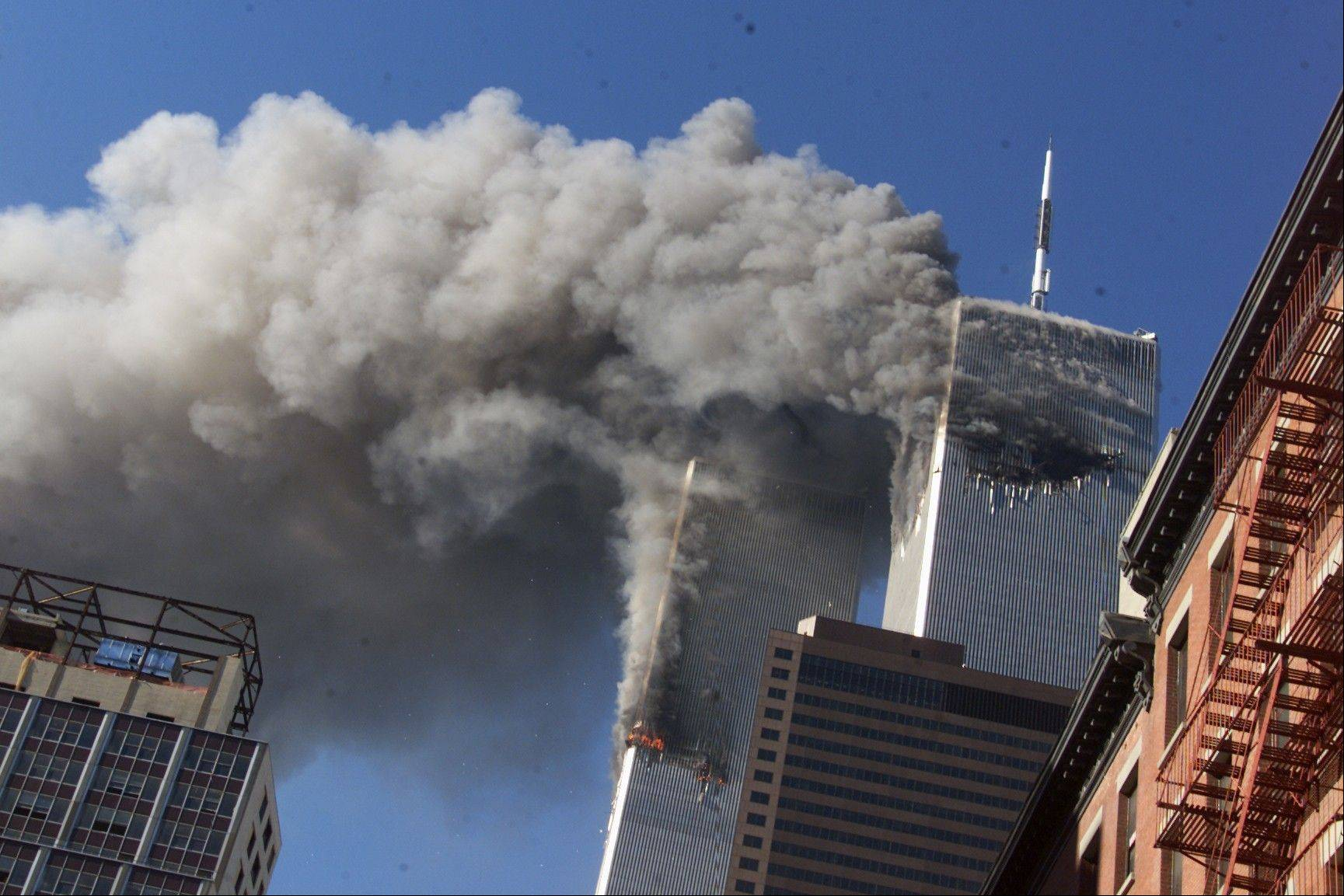 Smoke rises from the burning twin towers of the World Trade Center.