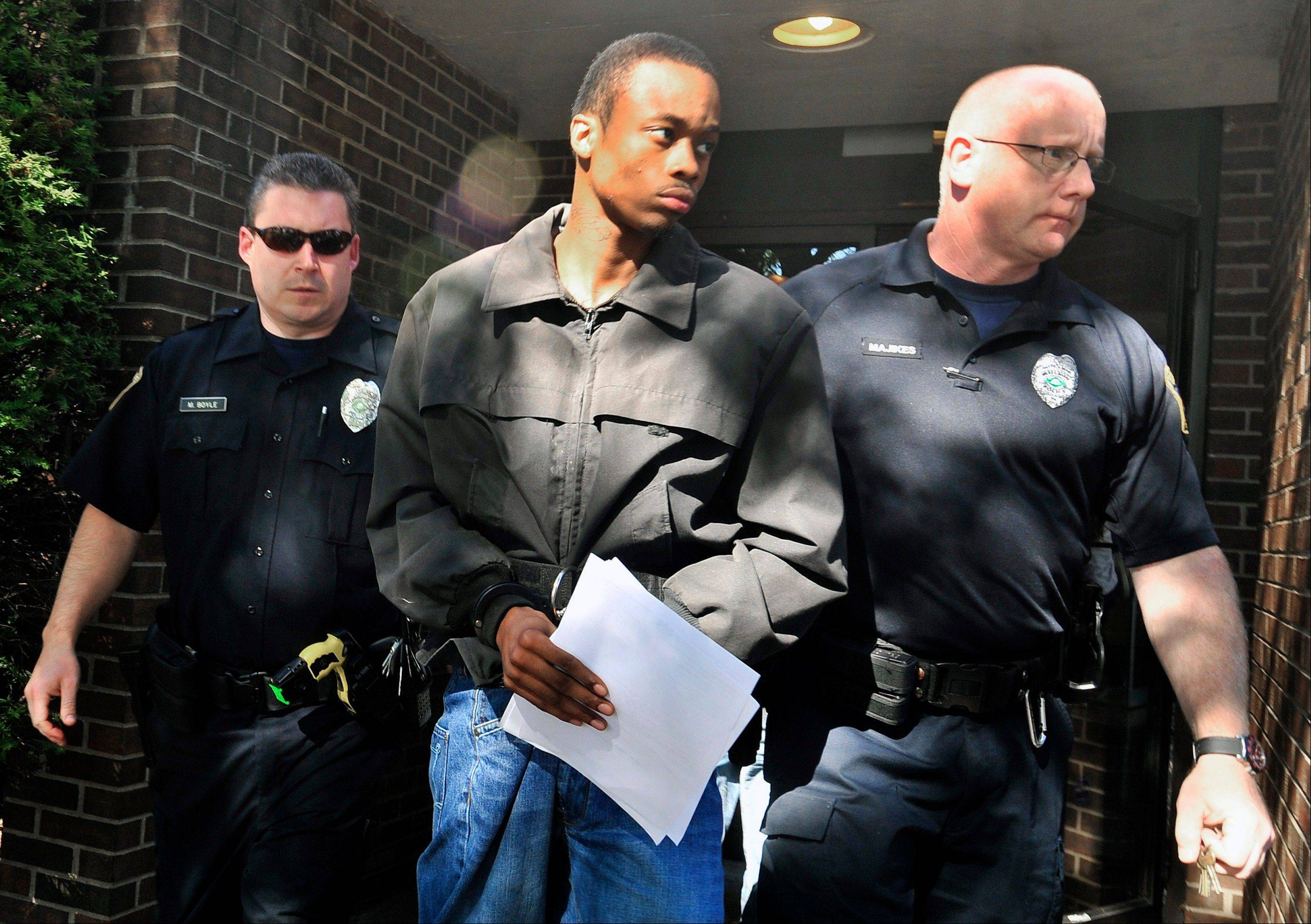 Daquan Breland is led out of Magistrate Rick Cronauers office Friday, in Wilkes-Barre, Pa. Breland, 23, and Daquan Wright, 19, were arrested in northeastern Pennsylvania on Friday in connection with the weekend shooting death of a toddler in a stroller in New York City.