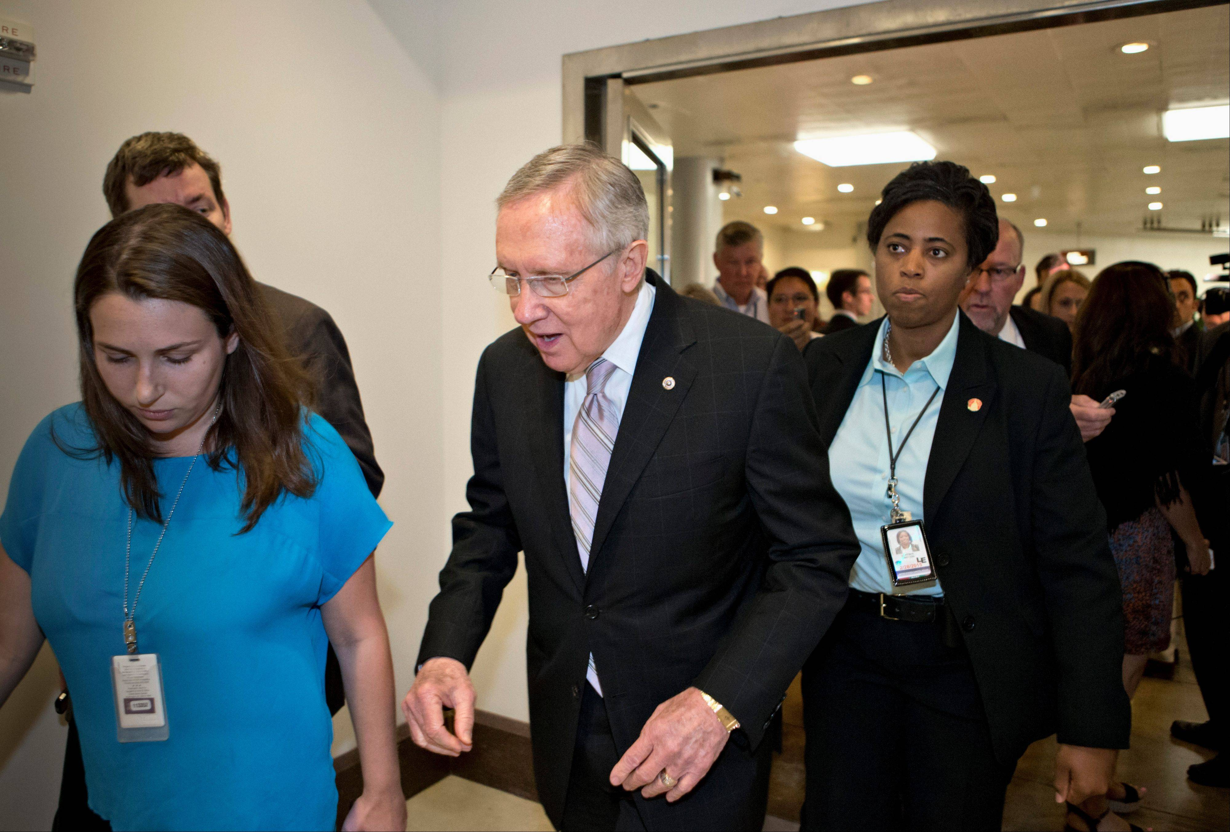 Senate Majority Leader Harry Reid of Nevada walks Friday to a closed-door briefing by national security officials on the situation in Syria on Capitol Hill in Washington.