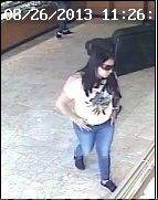 A store surveillance image from Precious Fine Jewelry shows a woman believed to have distracted a store employee during the Aug. 26 robbery of $185,000 worth of diamonds.