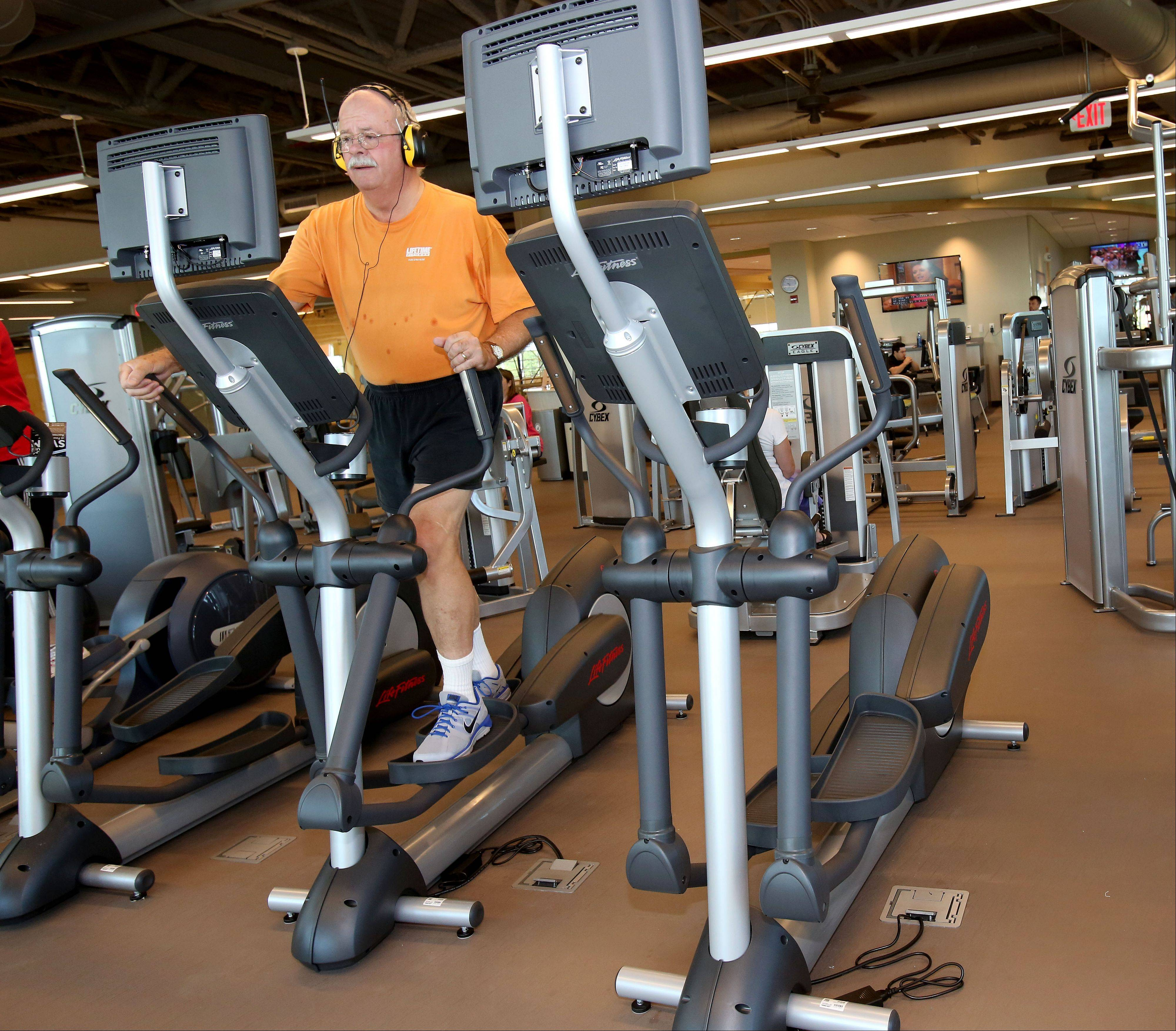 Mike Downey of Carol Stream, a part-time park district employee, uses an elliptical machine at the new Fountain View Recreation Center in Carol Stream.