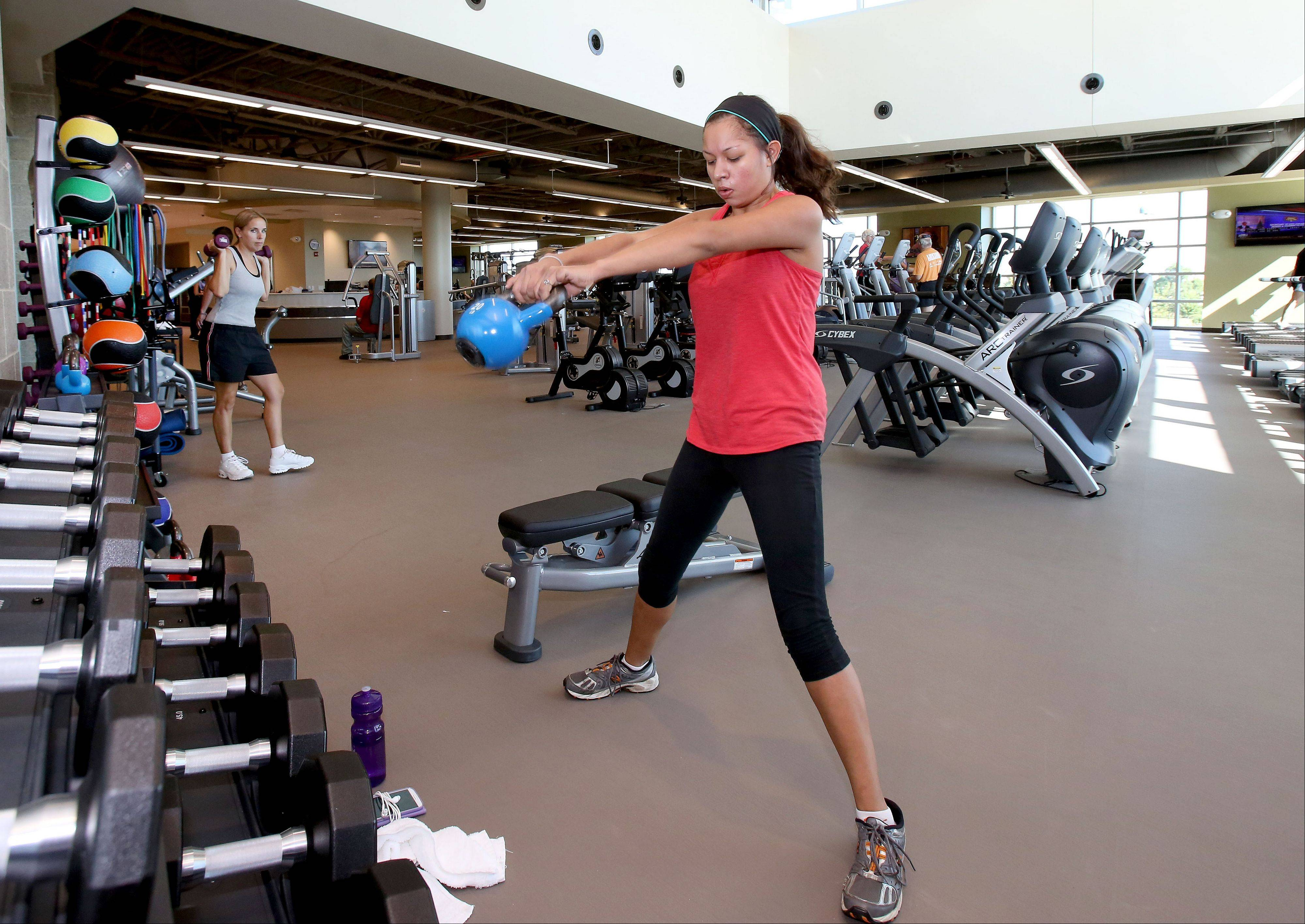 Amanda Reyes of Carol Stream works out at the new Fountain View Recreation Center in Carol Stream. The grand opening is Saturday.