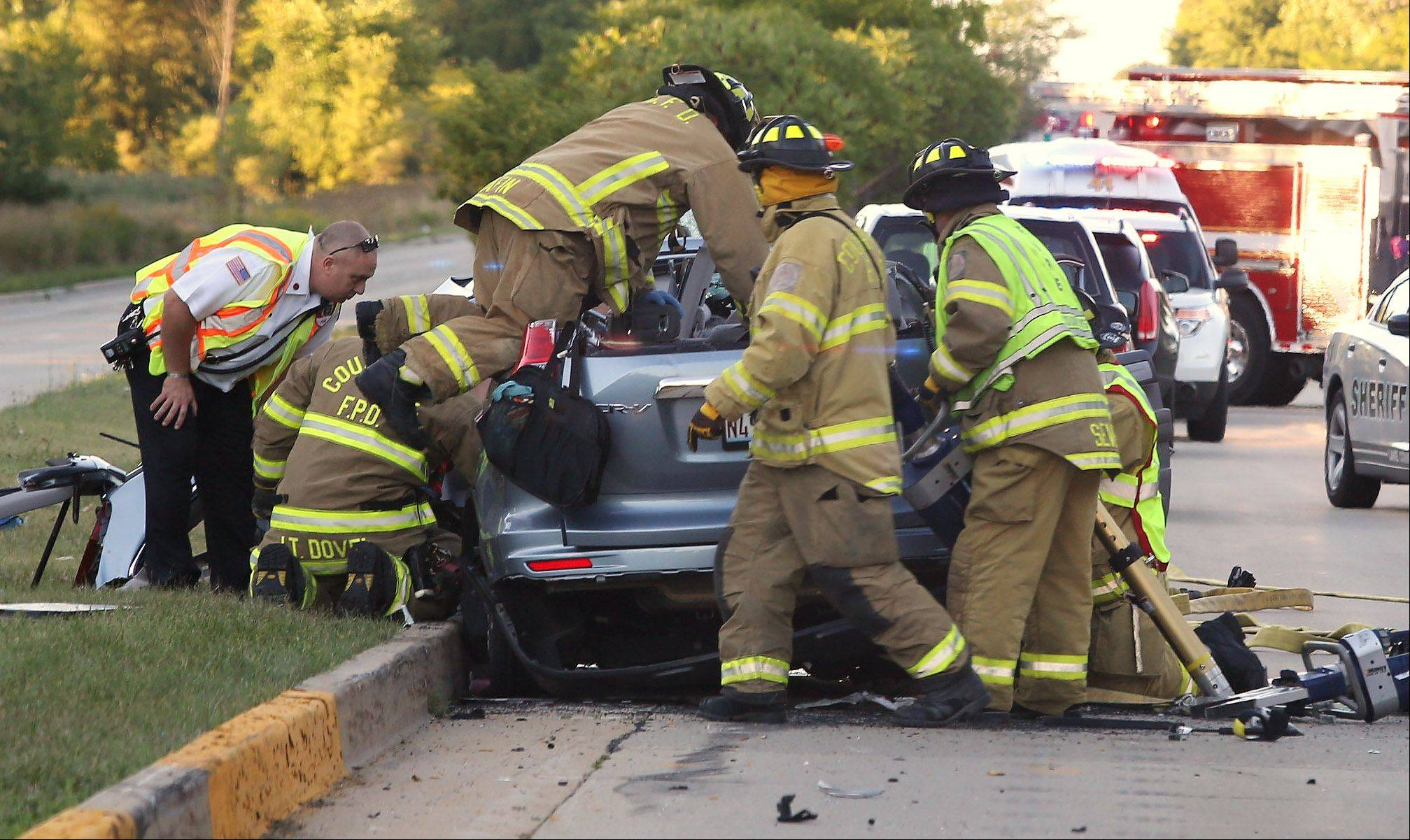 Countryside firefighters work to pull a person from an SUV after a multiple-vehicle accident on northbound Route 83 at West Moreland Road near Long Grove yesterday.