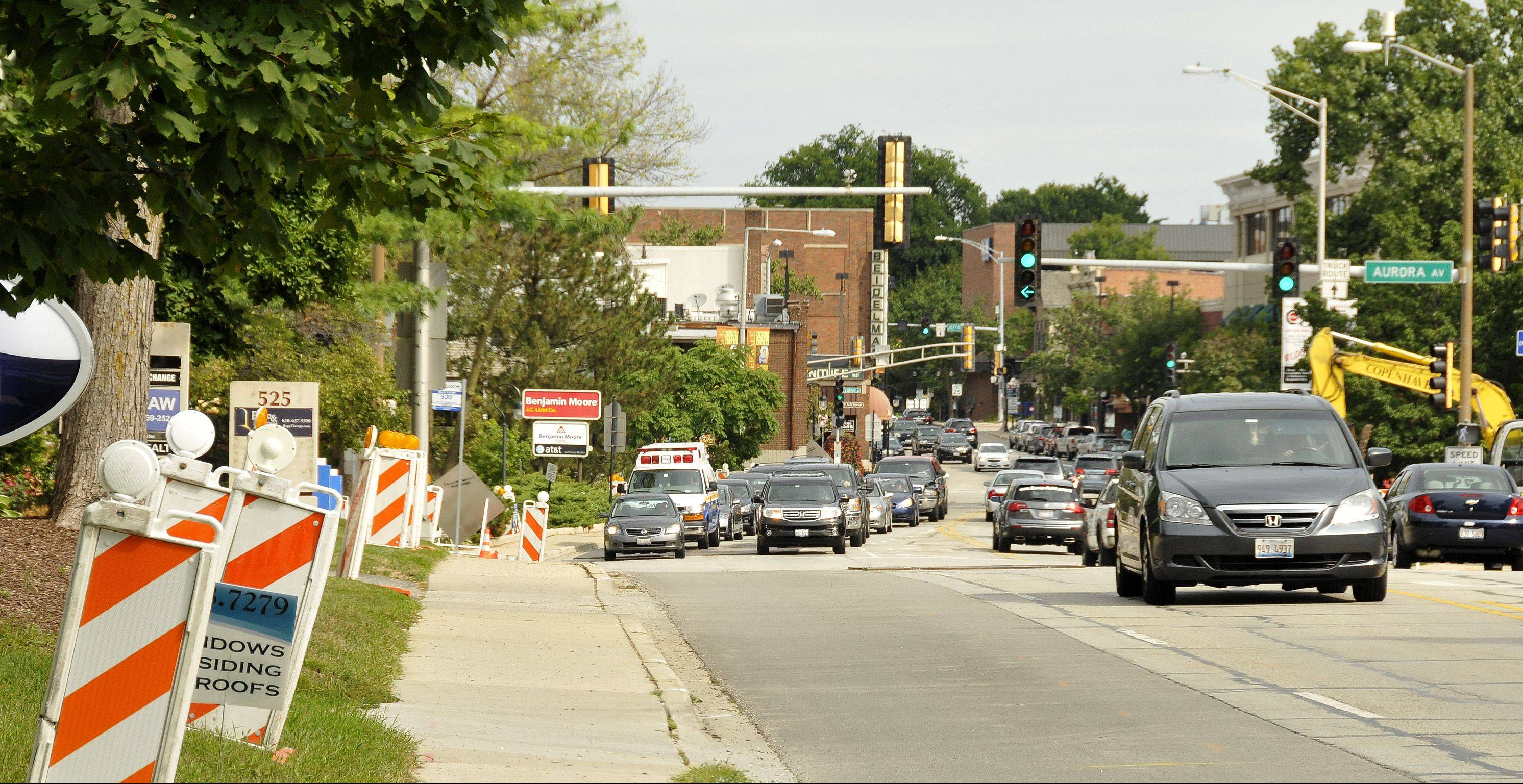 The lane closing markers are lined up along Washington Street in downtown Naperville in anticipation of a resurfacing project that starts Monday.