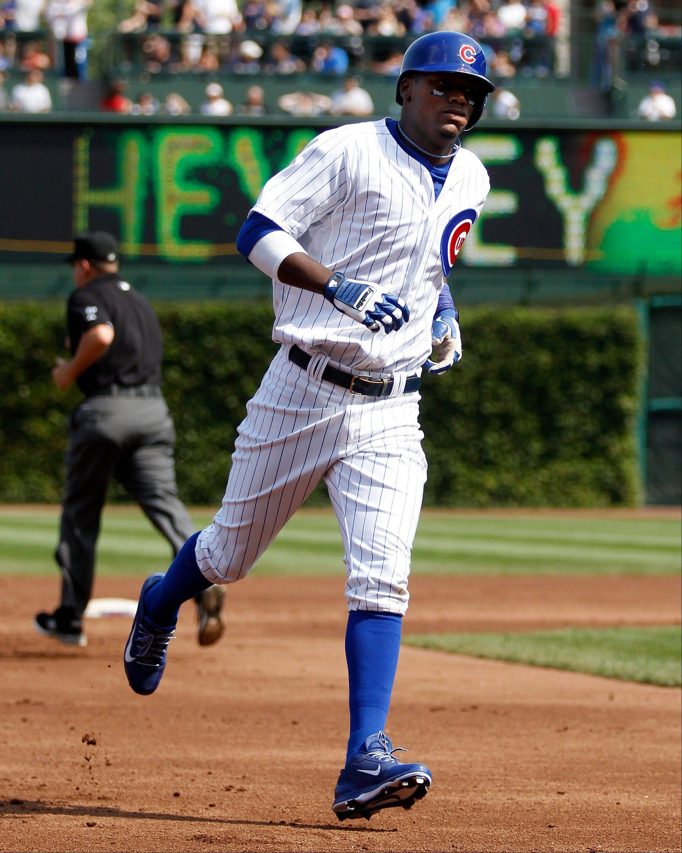 The Cubs' Junior Lake rounds the bases after hitting a grand slam in the first inning Friday against the Brewers at Wrigley Field.