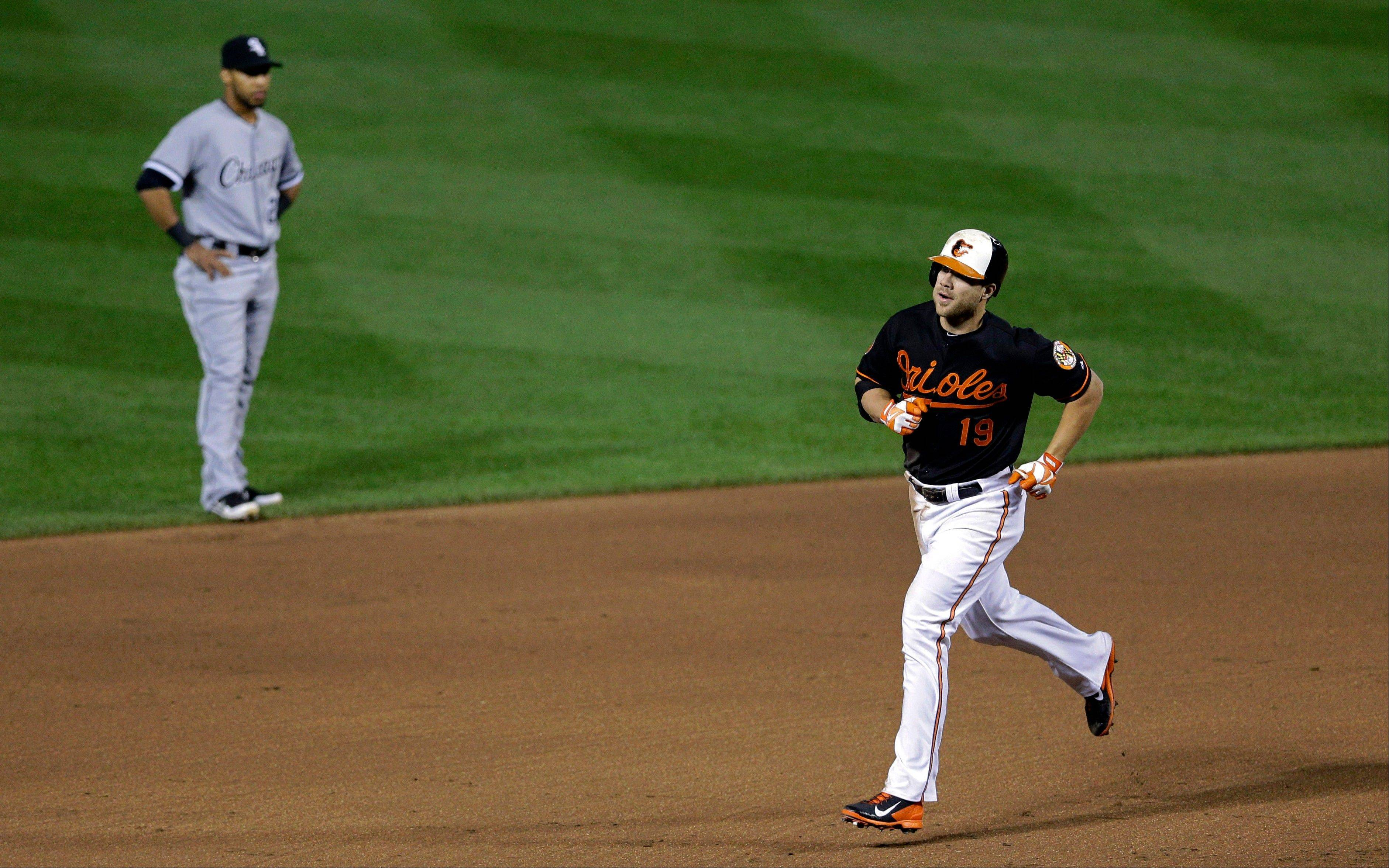 Baltimore Orioles' Chris Davis, right, rounds the bases past Chicago White Sox second baseman Leury Garcia after hitting a solo home run in the sixth inning.