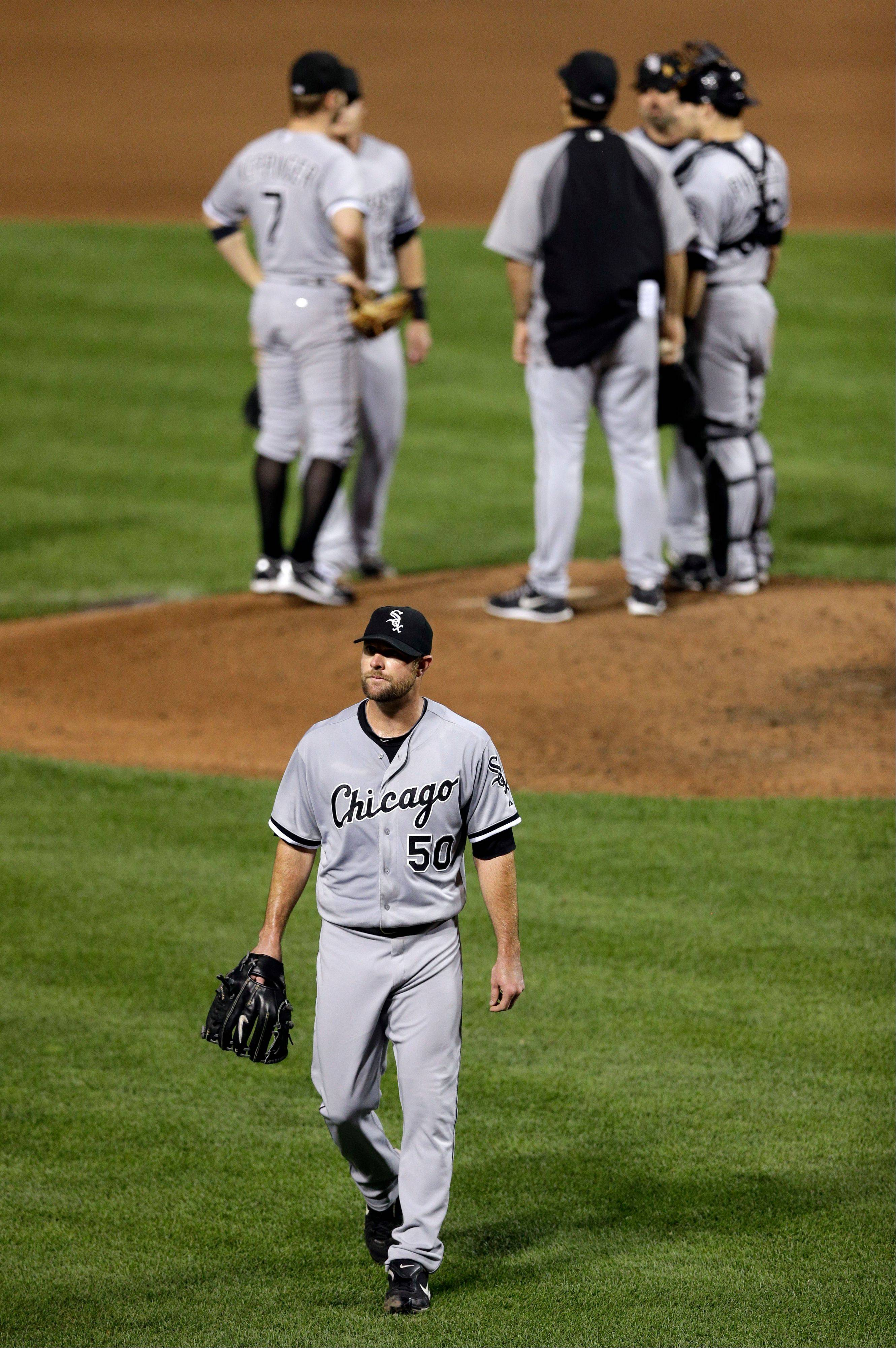 Chicago White Sox starting pitcher John Danks (50) walks off the field after being relieved in the sixth inning.