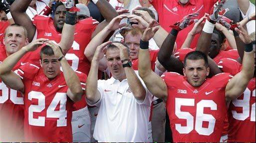 "Ohio State head coach Urban Meyer, center, sings ""Carmen Ohio"" with his players after their 40-20 win over Buffalo in last Saturday's season opener in Columbus, Ohio."