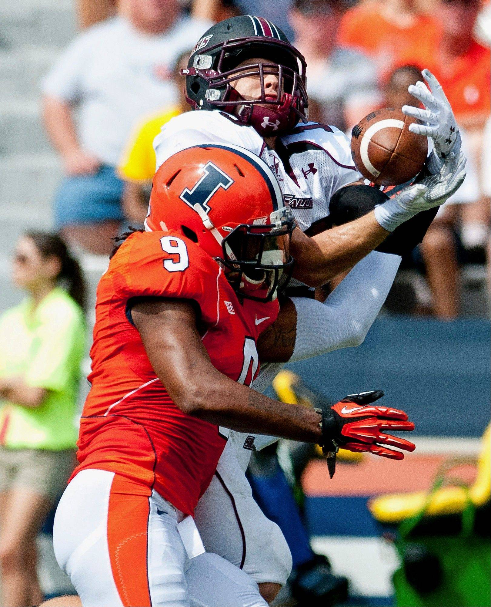 Southern Illinois wide receiver John Lantz makes a catch behind Illinois defensive back Earnest Thomas last Saturday in Champaign. Illinois' defense was a liability in the season opener against SIU.