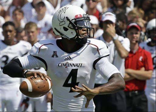 Cincinnati quarterback Munchie Legaux passes against Purdue in the second half of last week's game in Cincinnati. Head coach Tommy Tuberville hasn't announced a decision on a starting quarterback between Legaux and Brendon Kay for the Illinois game.