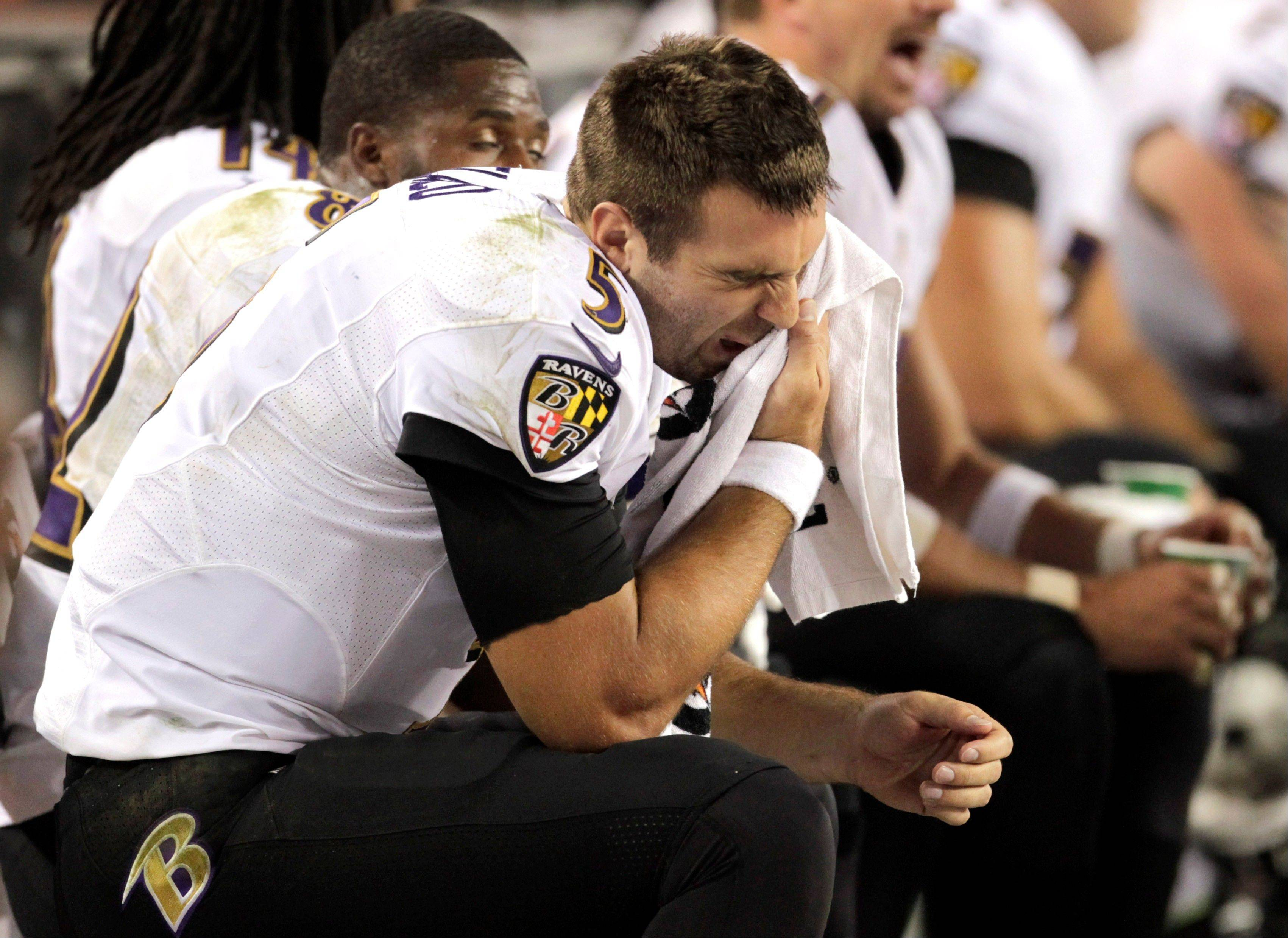 Baltimore Ravens quarterback Joe Flacco sits on the bench during the second half of an NFL football game against the Denver Broncos, Thursday, Sept. 5, 2013, in Denver.