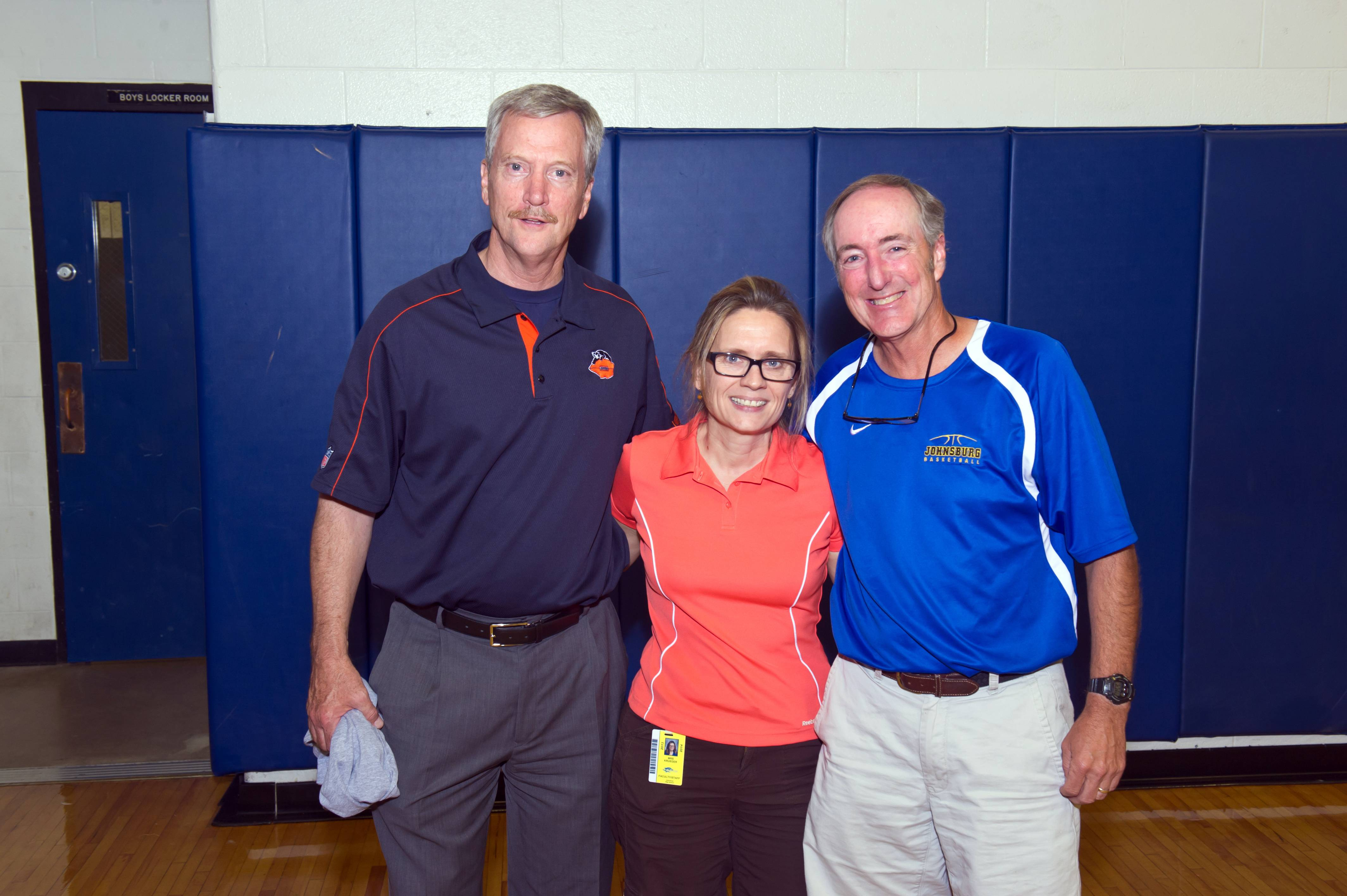 Symetra Heroes in the Classroom honoree Rick Bailey (right) is congratulated by Chicago Bears Chairman George McCaskey (left) and fellow Johnsburg High School teacher Judy Krueger (center), who nominated Bailey for the award, which recognizes educational excellence.
