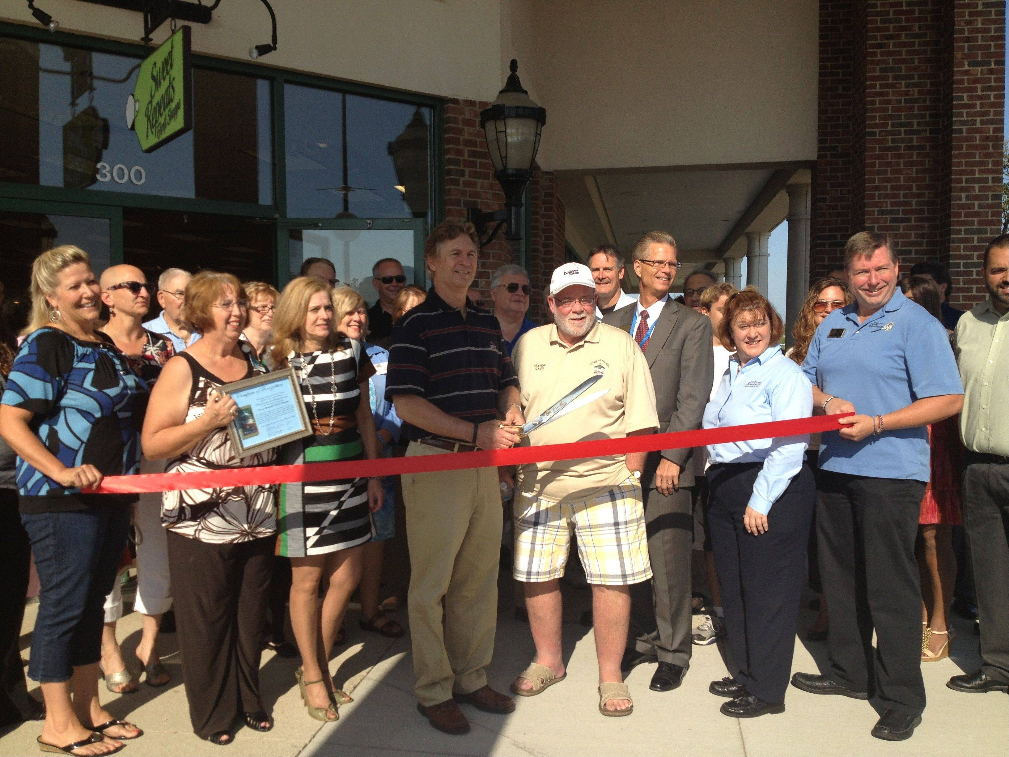 Pioneer Center CEO Patrick Maynard and Huntley Mayor Chuck Sass cut the ribbon at the grand opening of the new location for the Sweet Repeats Thrift Shoppe on Aug. 16.