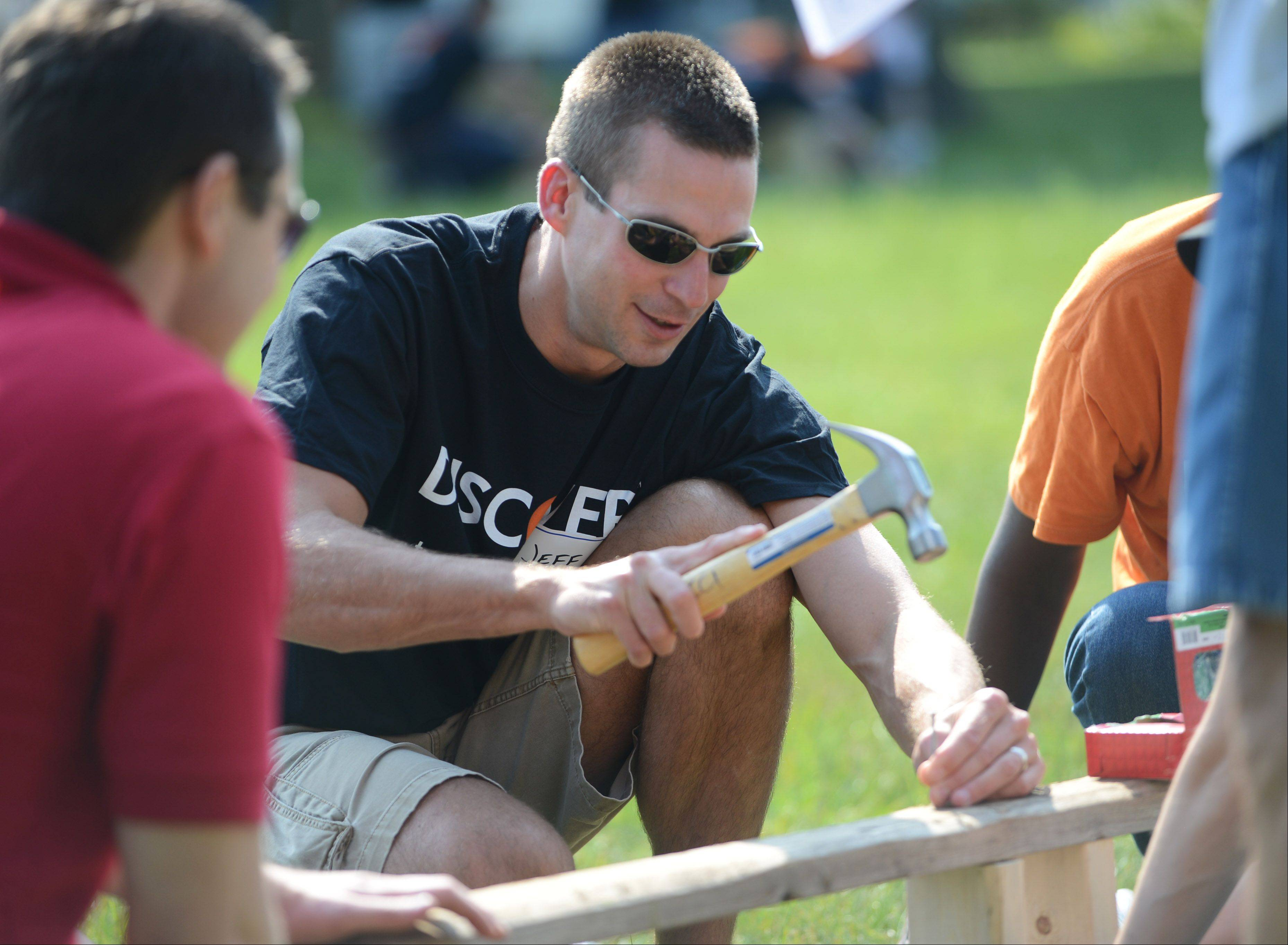 Jeff Krueger, of Northbrook, works on installing benches near the playing fields.