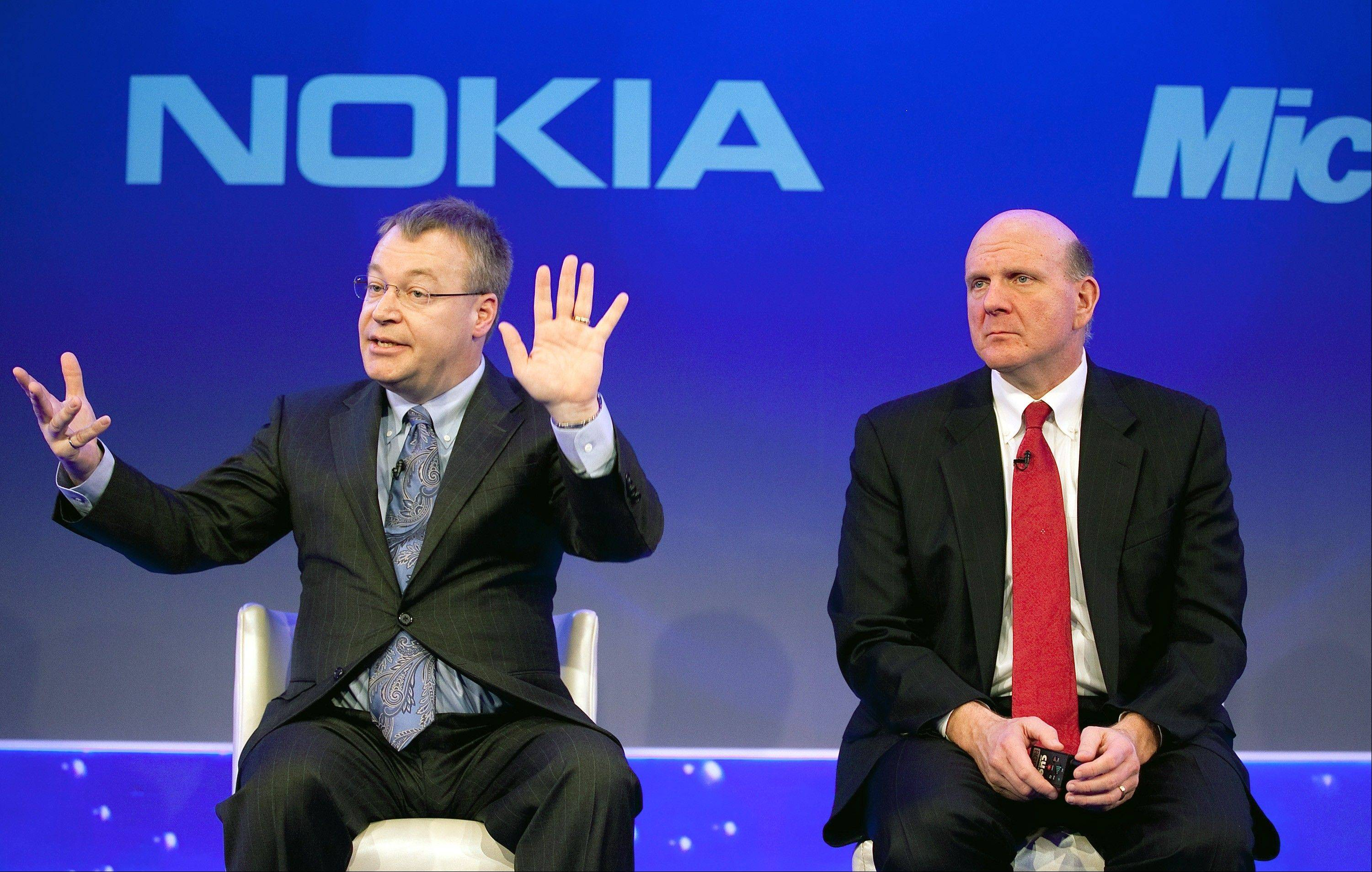 Stephen Elop, chief executive officer of Nokia Oyj, left, speaks as Steve Ballmer, chief executive officer of Microsoft Corp., listens while onstage at the Nokia capital markets day in London, U.K., on Friday, Feb. 11, 2011. Microsoft Corp. agreed to buy Nokia Oyj�s handset business and license its patents for $7.2 billion, casting together the lot of two companies trying to stay relevant against fleet-footed technology rivals.