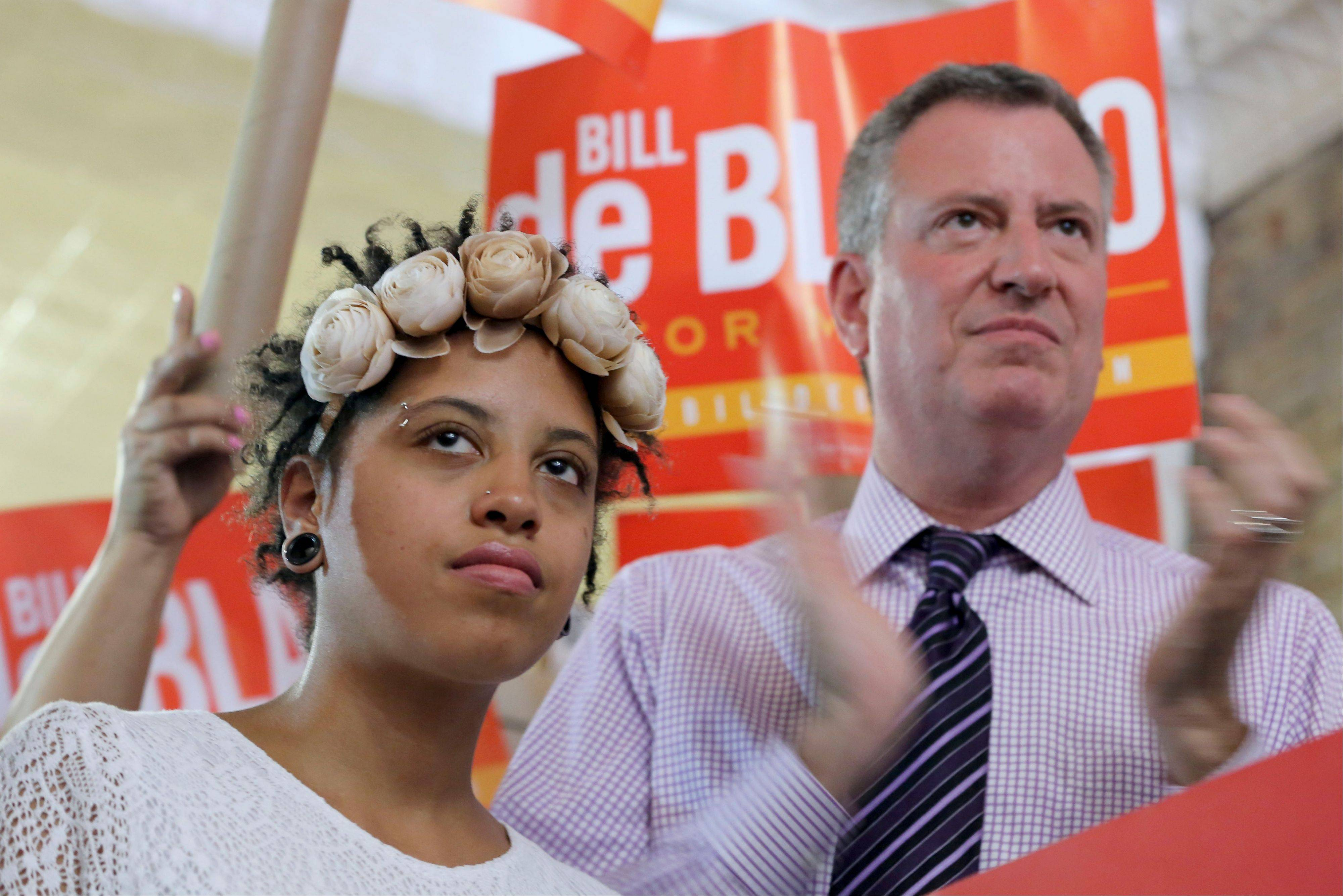 Democratic mayoral hopeful Bill de Blasio, right, is joined by his daughter Chiara, during a campaign rally Saturday in the Brooklyn borough of New York. The Democratic primary election is Tuesday.