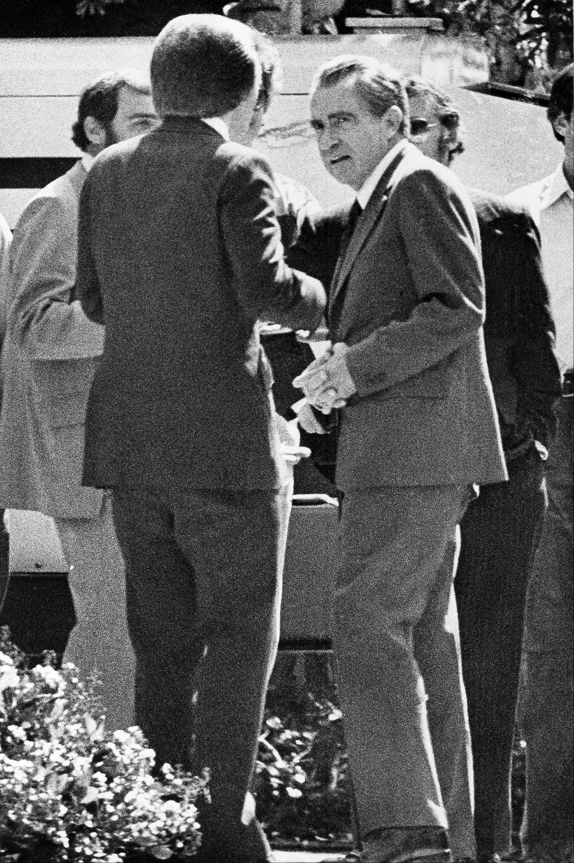 Former President Richard M. Nixon bids goodbye to British commentator David Frost, left, following the last taping of their 12 interviews in Laguna Beach, Calif.