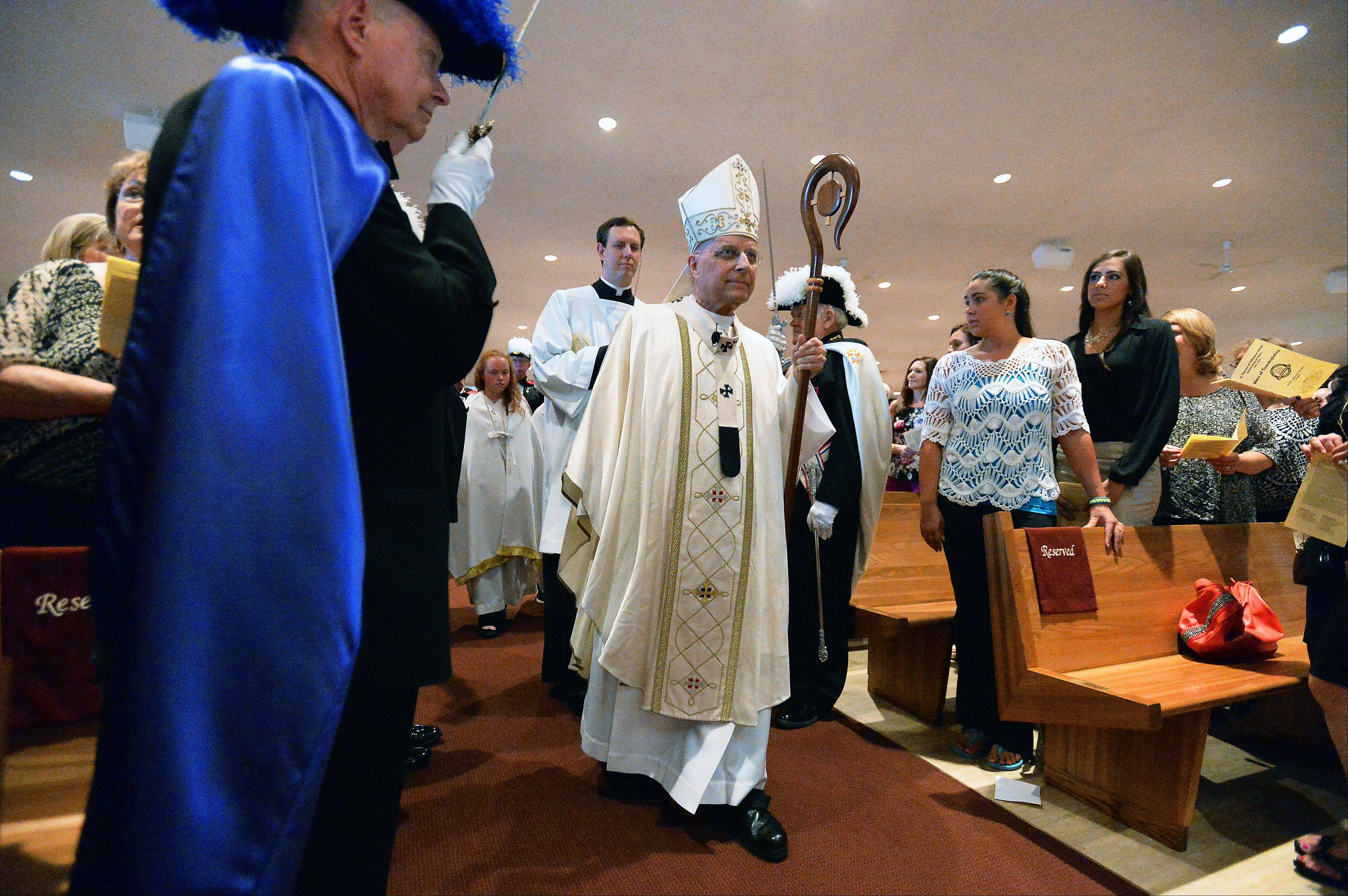 Cardinal Francis George walks to the altar at St. Thomas of Villanova Catholic Church in Palatine during a Mass of thanksgiving celebrating the school�s 50-year anniversary on Saturday.