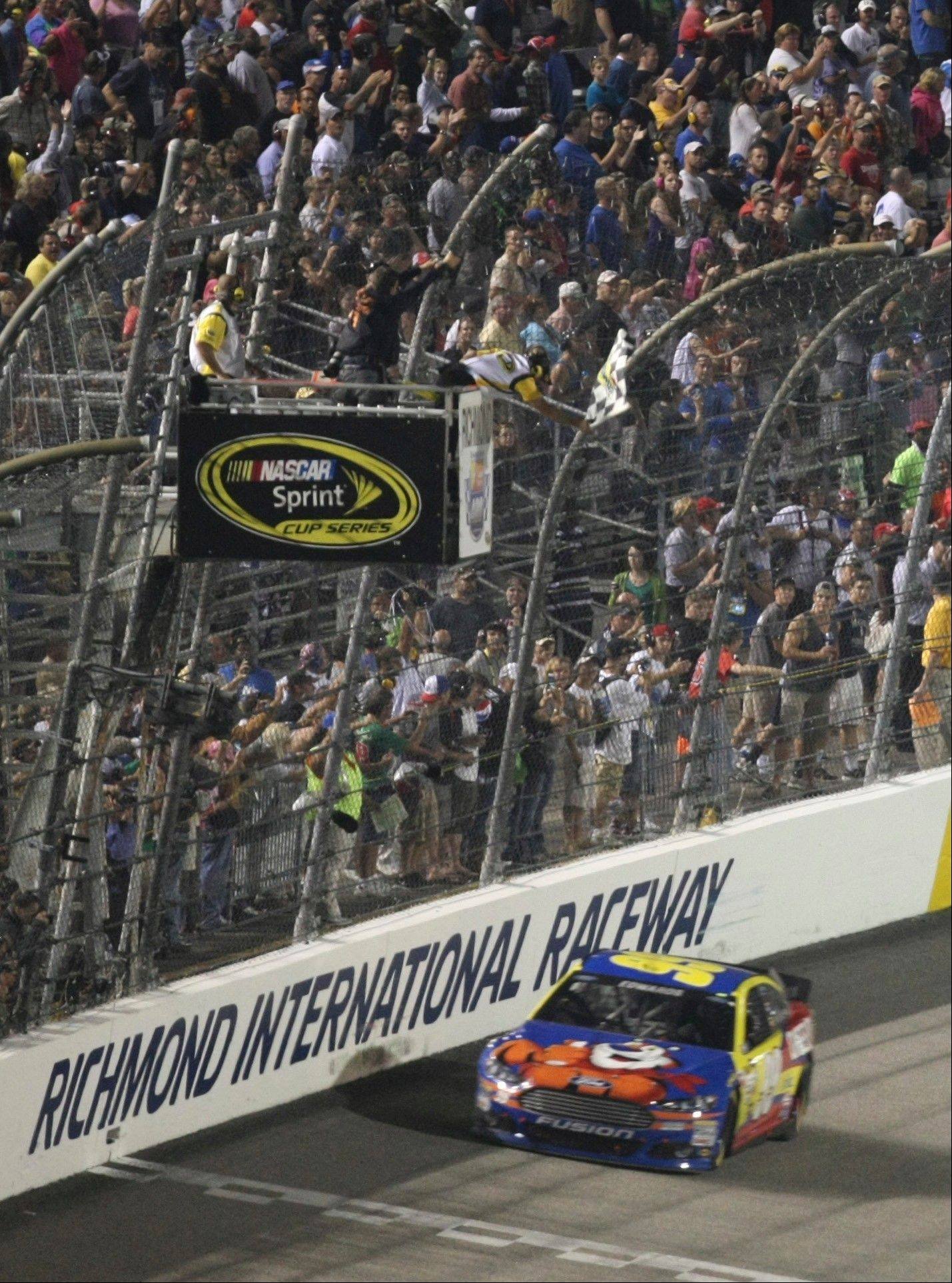 Carl Edwards approaches the finish line to win the NASCAR Sprint Cup Series race Saturday at Richmond International Raceway in Richmond, Va.